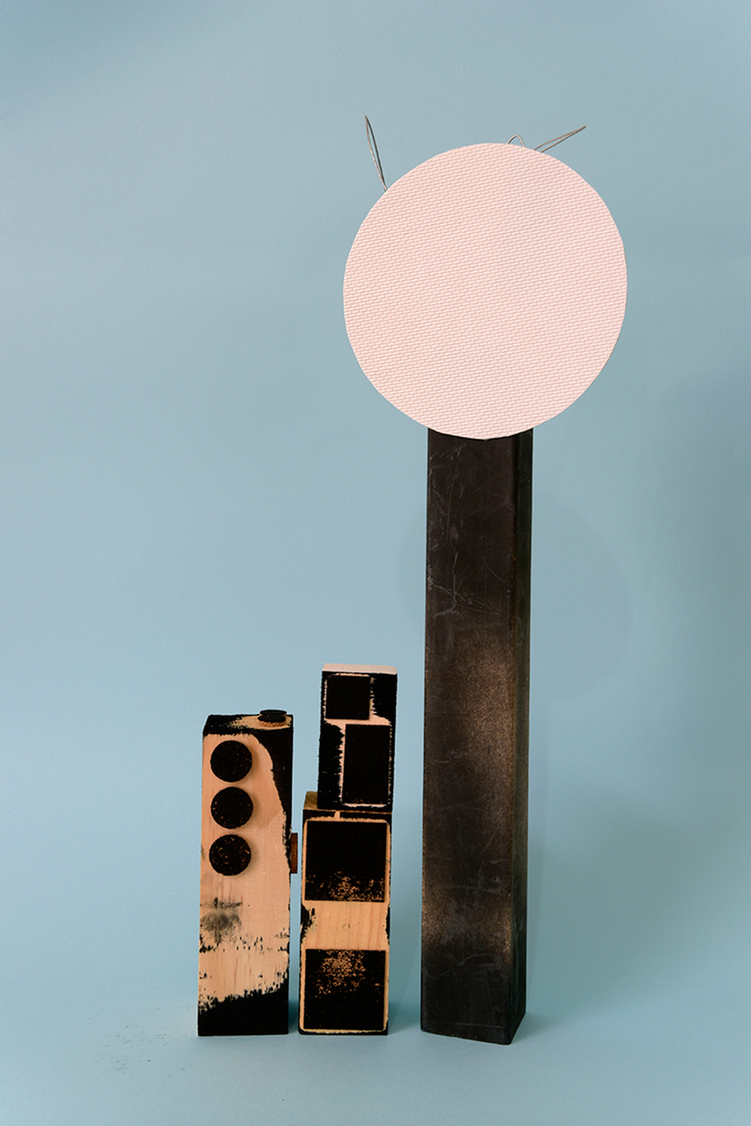 Hardbody Sculpture I (black stamps and white disc)