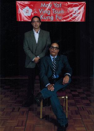 Sigung Moy Yat Tung (left) with his Sifu, Grandmaster Moy Tung (seated).