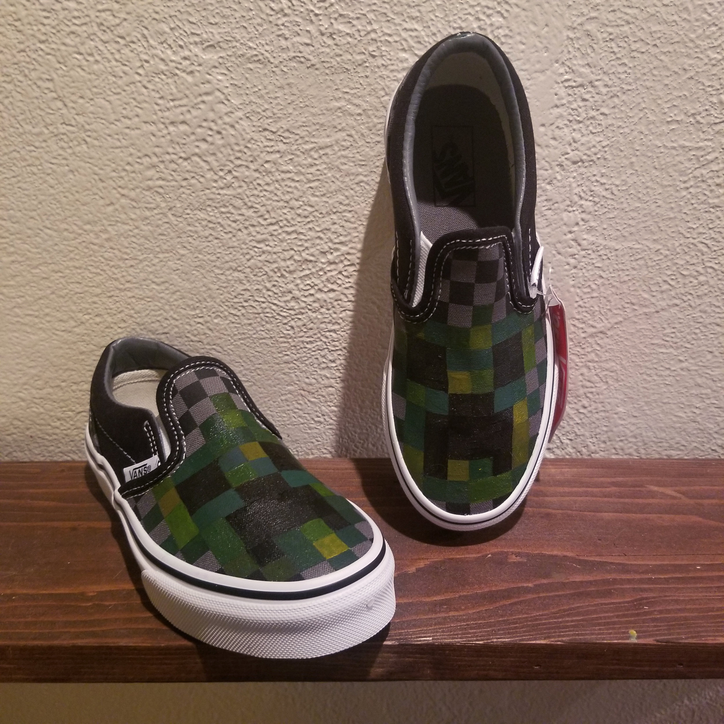 A pair of Minecraft-inspired Vans I painted for my nephew's b-day, 2019.