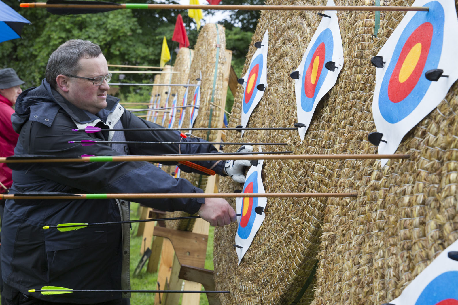 Dennis Nutt removes arrows from the targets during the butt round of the Ancient Society of Kilwinning Archers open Papingo. The butt round was held to determine the order in which the archers would compete.
