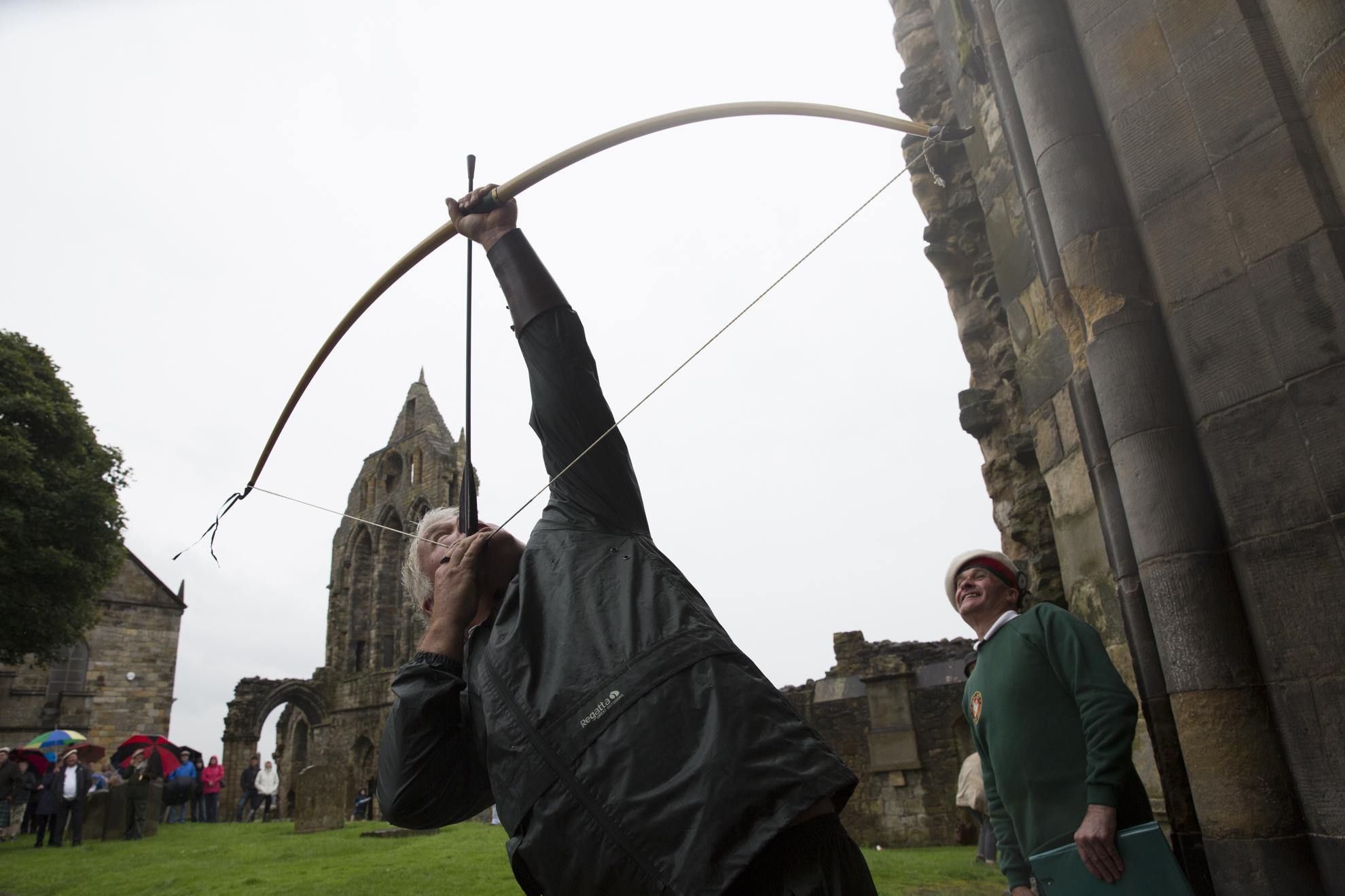 British Longbow Society member Kim Manuel, of Somset, England, aims for the wooden pigeon at the top of the Kilwinning Abbey Tower during the open Papingo in Kilwinning, Scotland.
