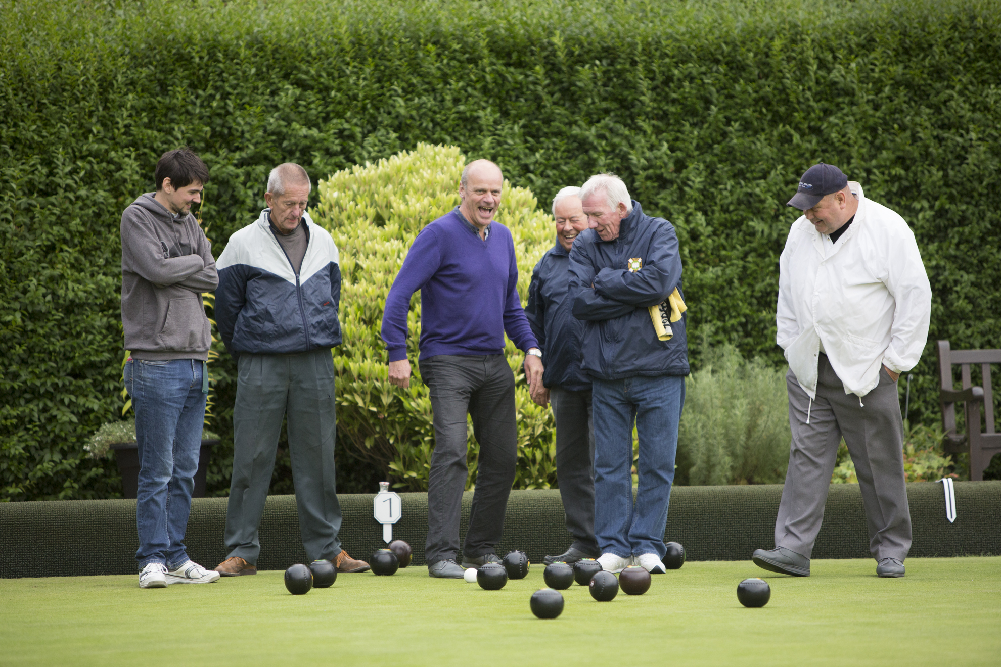From left; Alexander Patrizio, Trevor Thomas, Peter Morris, Jack Young, Ian Cairns and Ken Williamson watch the progression of the bowls while playing during hat night at Maitland Bowling Club in Edinburgh.