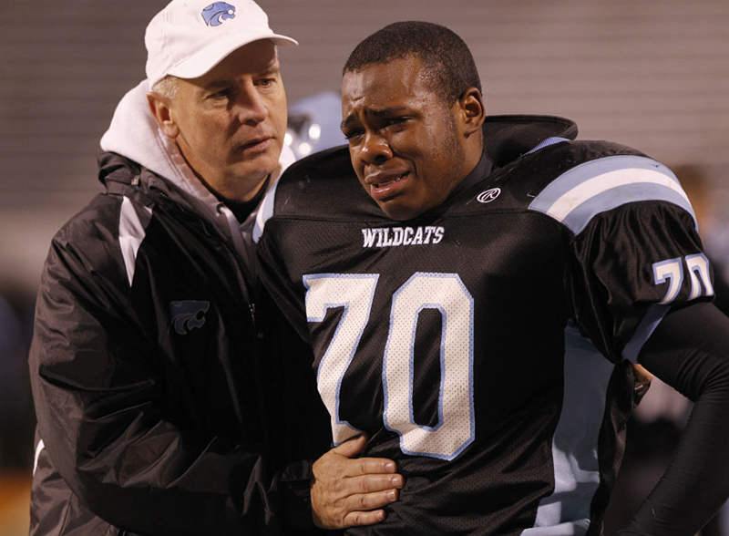 Centreville High School principal Mike Campbell talks with Josh Smith (70) in the second half of the during the Virginia AAA Division 6 high school football final at Scott Stadium Saturday, Dec. 10, 2011. Oscar Smith beat Centreville 47-21. Copyright: The Daily Progress