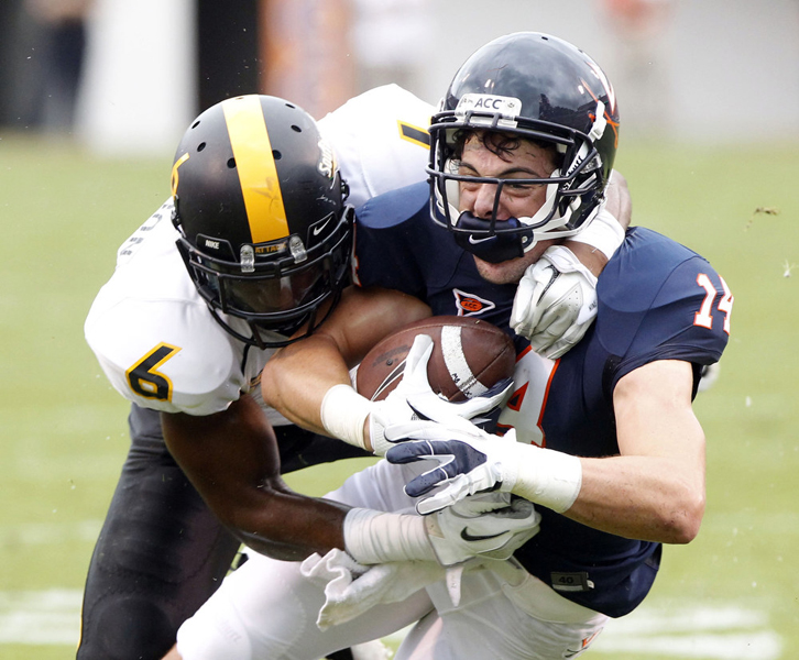 Southern Miss. Golden Eagles defensive back Martez Thompson (6) tackles Virginia Cavaliers wide receiver Matt Snyder (14) during the first half of the game between the Virginia Cavaliers and the Southern Miss. Golden Eagles at Scott Stadium Saturday, Sept. 24, 2011.  Copyright: The Daily Progress