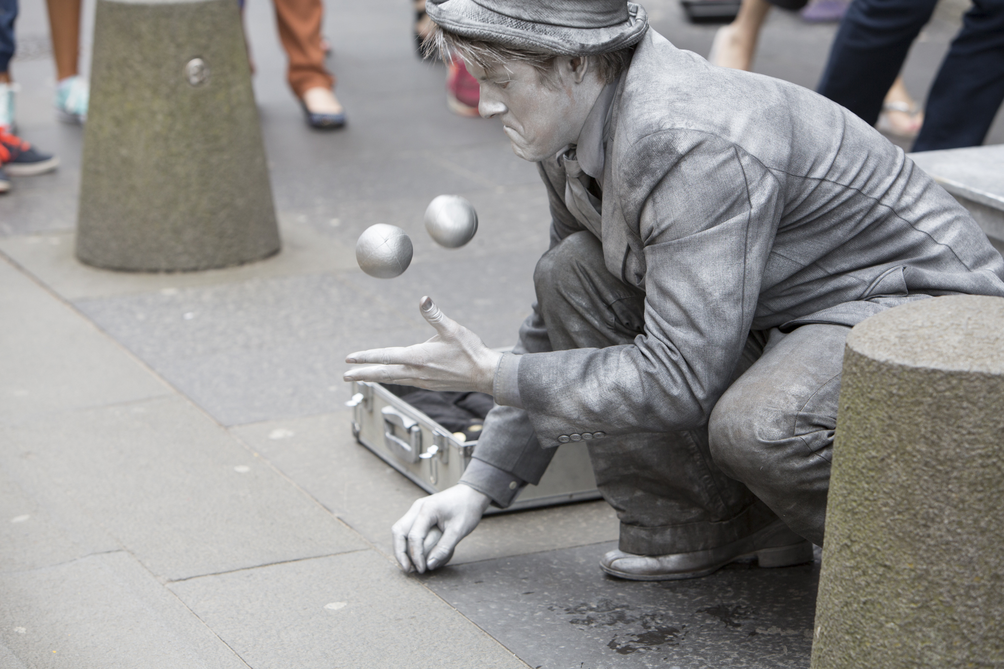 John Godbolt, from Bristol, England, performs as a juggling statue in front of St. Giles Cathedral on the Royal Mile during the 2014 Edinburgh Festival of the Fringe in Edinburgh, Scotland.