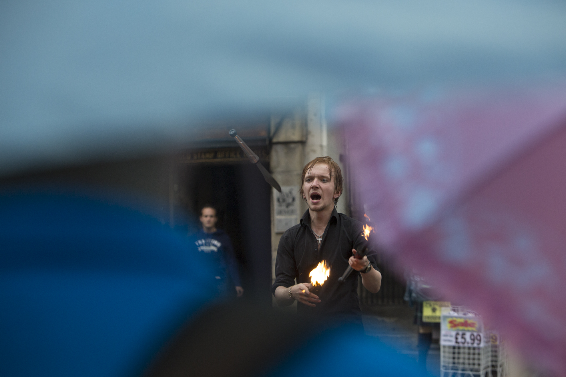 Tommy Everson performs in front of a crowd in the rain during the Edinburgh Festival of the Fringe in Edinburgh, Scotland.