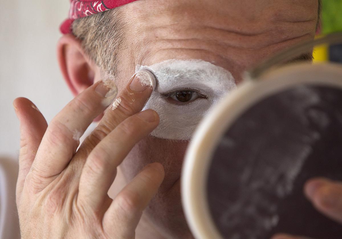 John Sayre, aka J.P. Ballyhoo, prepares his clown face before the afternoon show.