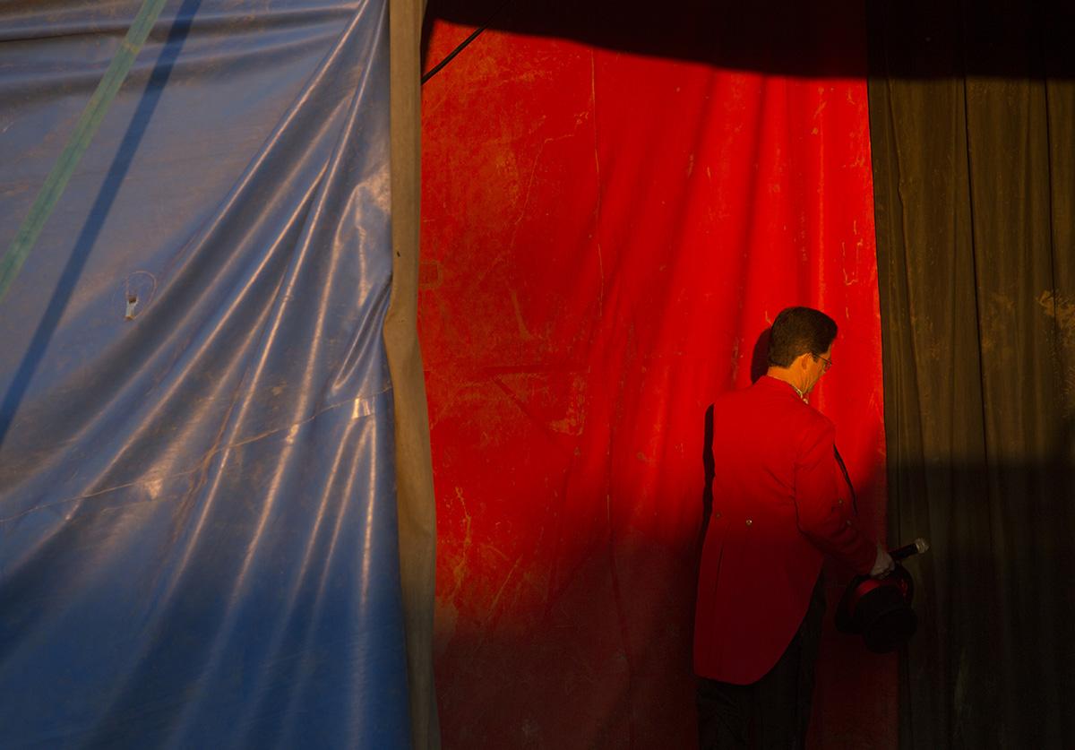 Ringmaster John Moss II enters the circus tent.