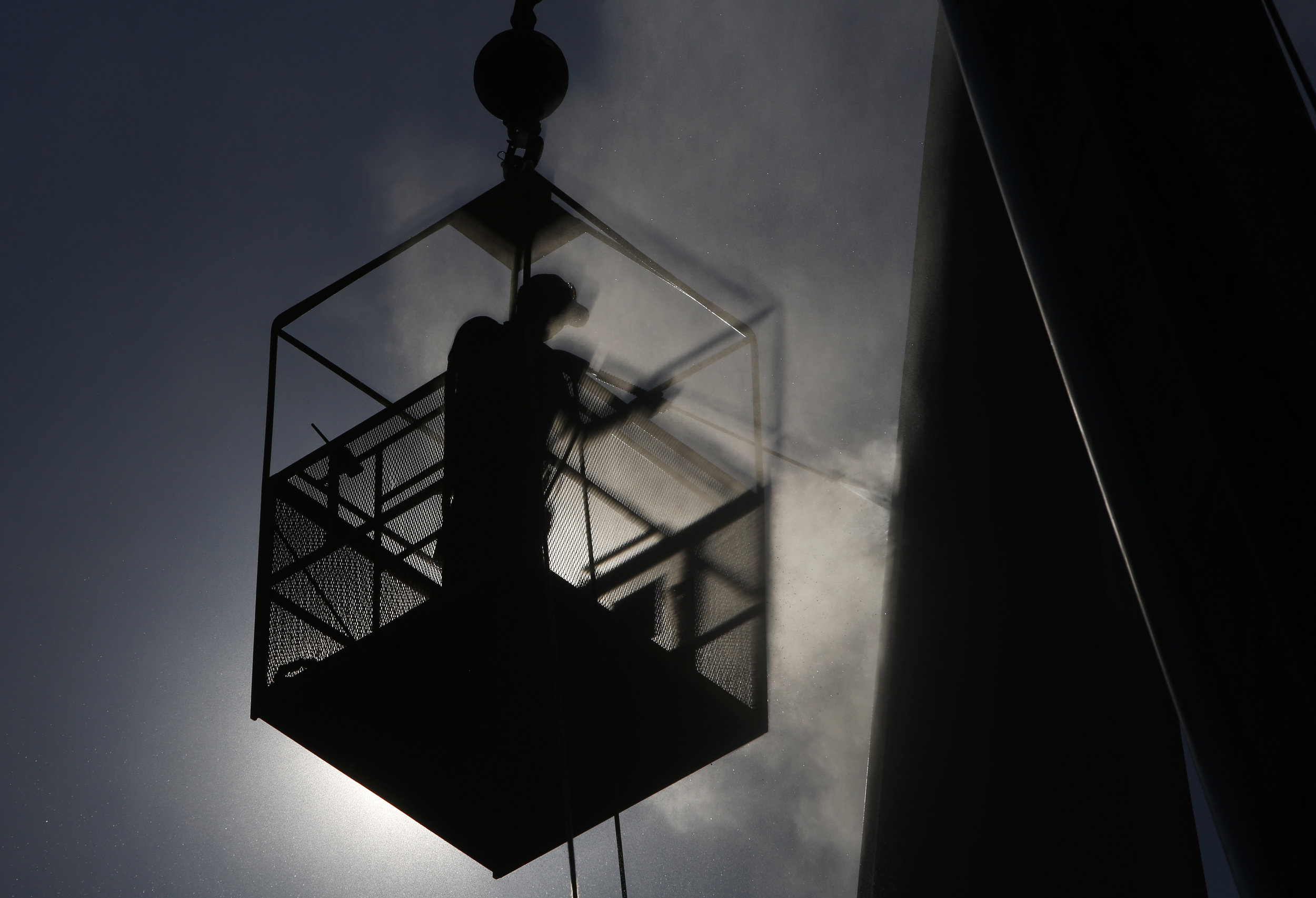 Trevor Ronan power washes the steeple at Yorkminster Presbyterian Church Wednesday, August 31, 2016. The top is approximately 80 feet from the ground. The power washing service was volunteered by Ronan's father's company, George Ronan Powerwash. Copyright: The Daily Press