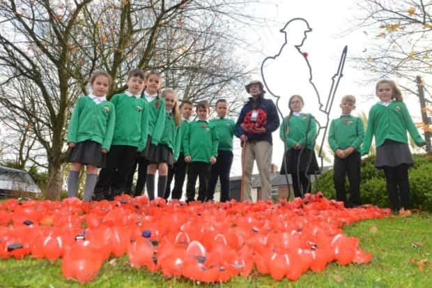 Resident veteran air gunner Tom Douglas alongside West Rainton primary School Children