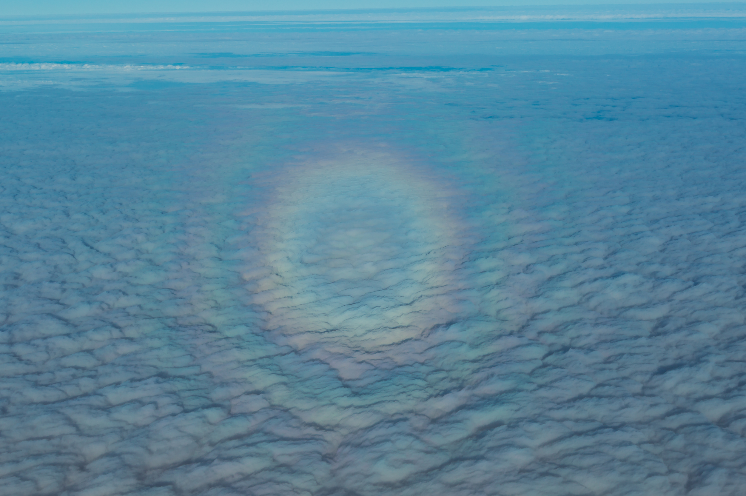 Complete rainbow above the clouds.jpg