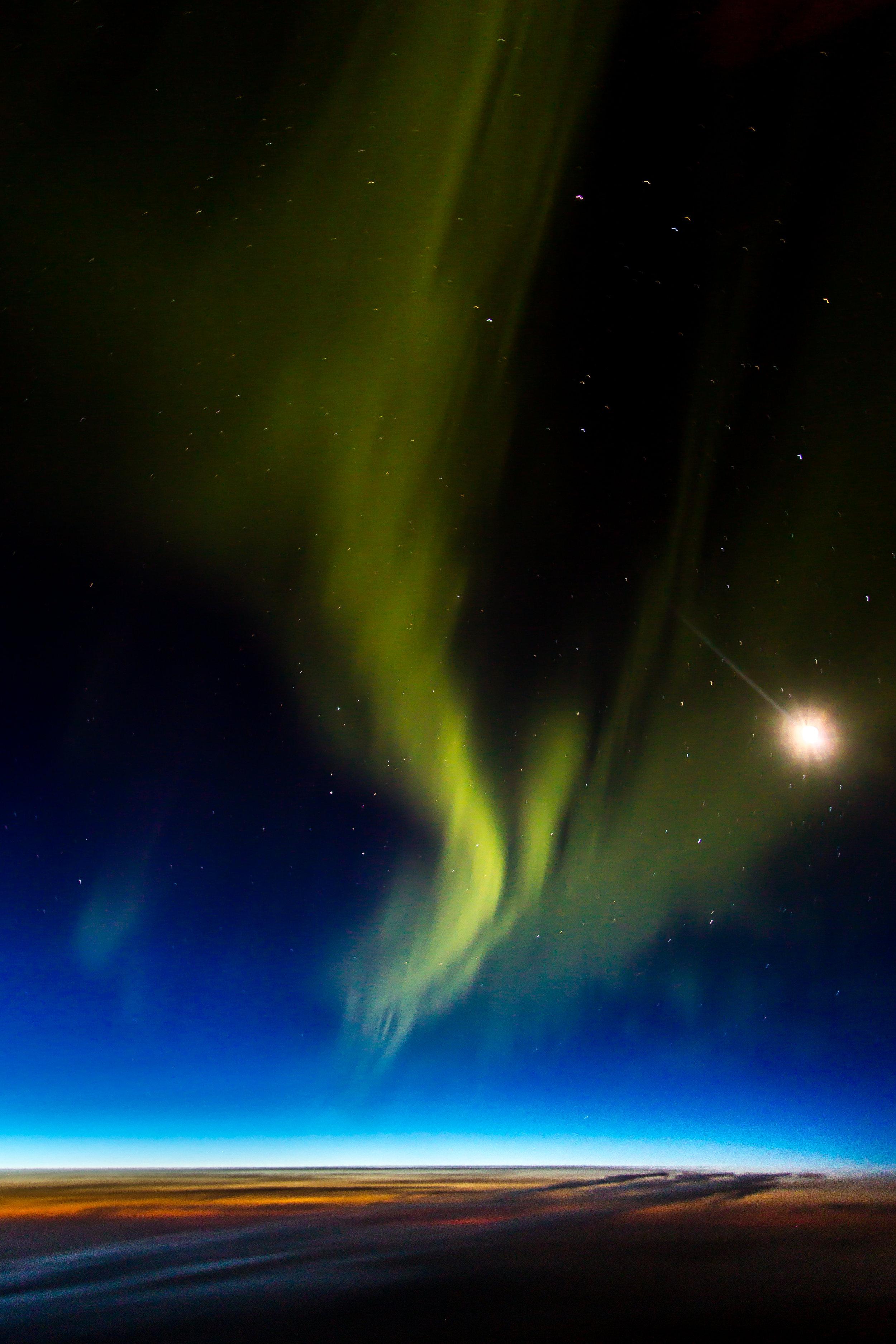 Aurora Borealis above the clouds.jpg