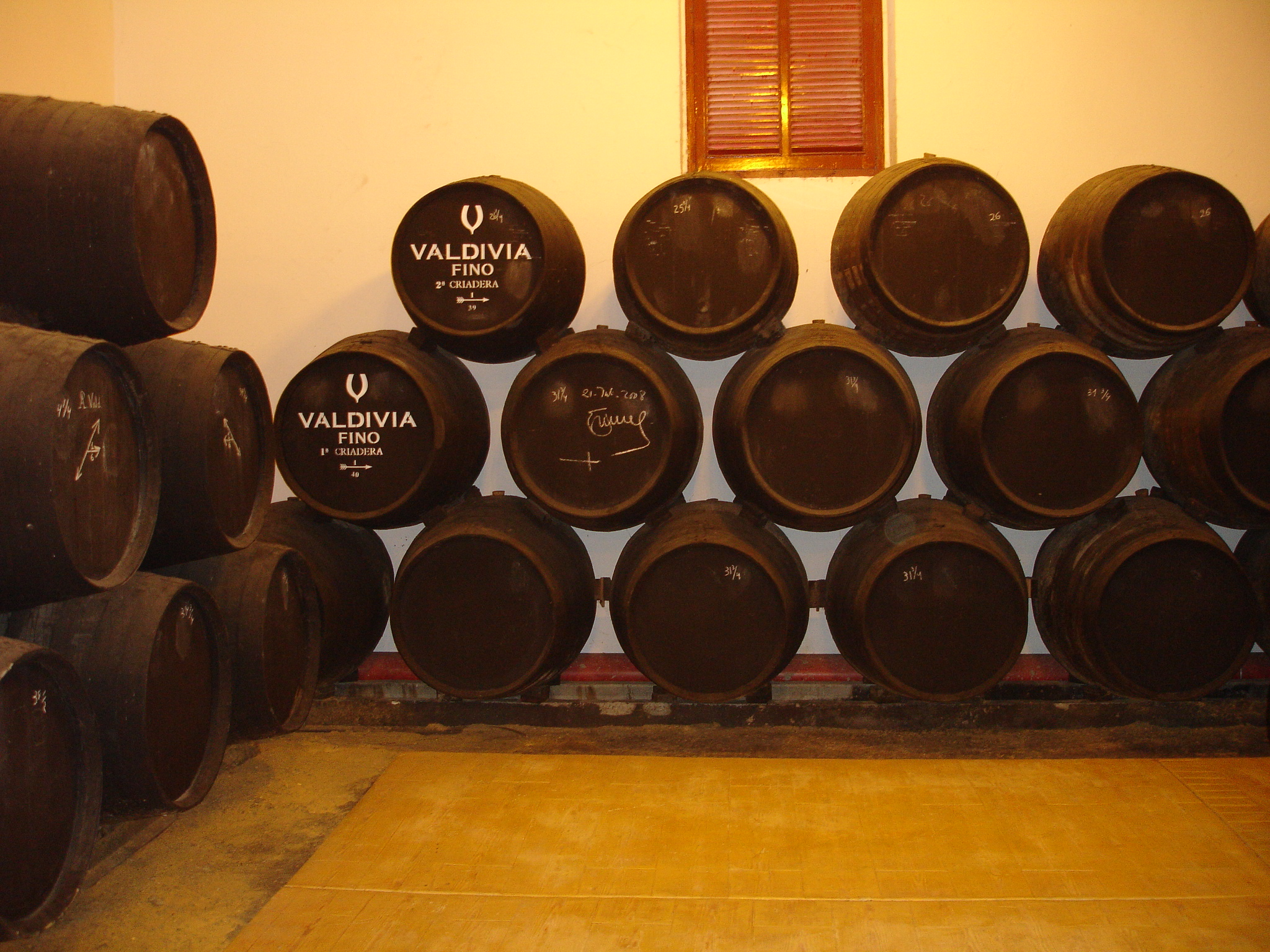 A Solera of Sherry wine casks. Image via Wikimedia Commons. https://en.wikipedia.org/wiki/File:ValdiviaJerez52.jpg