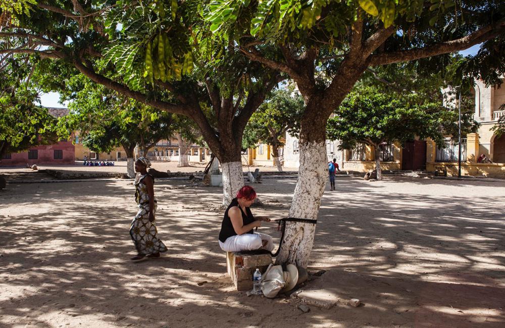 """Nadia Myre at Work as part of the """"Formes et Paroles"""" exhibition residency on Gorée Island, Senegal November 2014. Courtesy Musée Dapper, Paris. Photo Aurélie Leveau."""