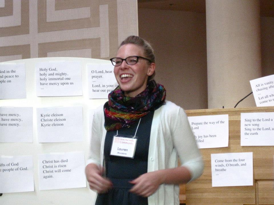A workshop participant improvises a melody using a text such as those seen behind her.