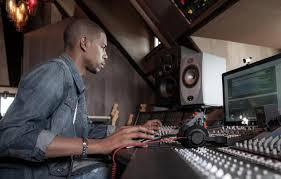 Producer/engineer Young Guru, mulling tradeoffs at the mixing console. Image via massappeal.com .
