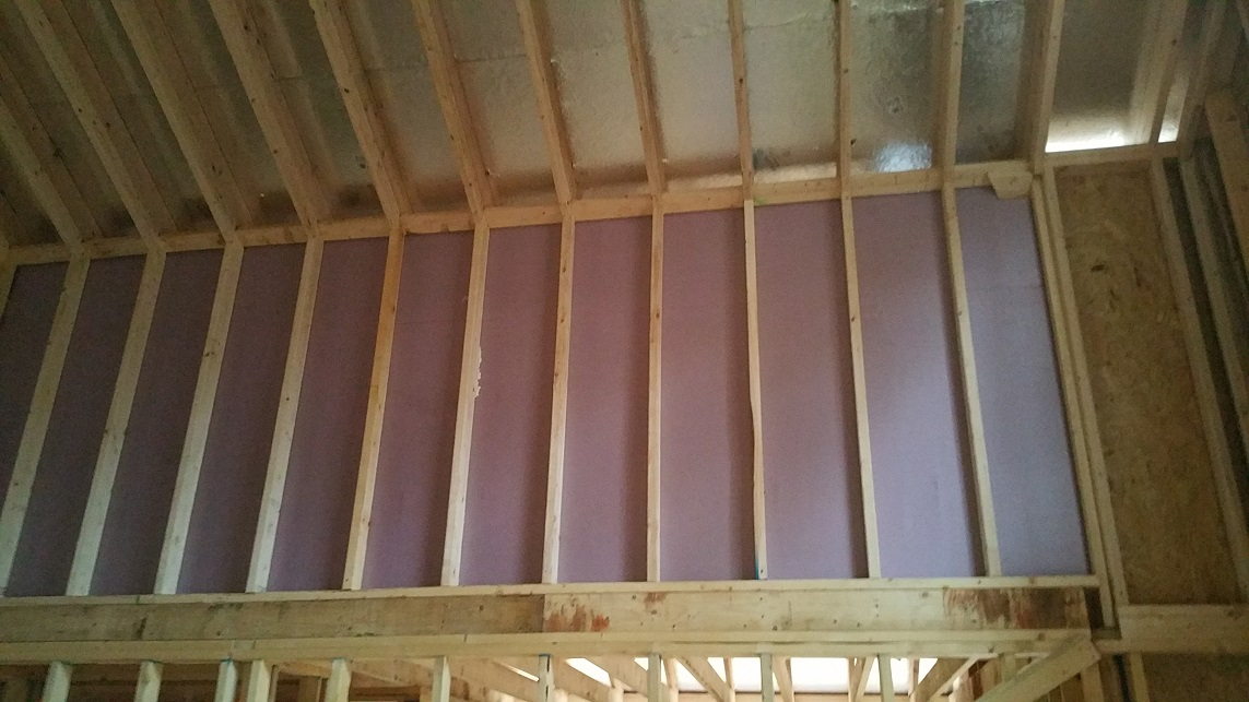 Foam board and Hilti spray foam were used as an air barrier between the attic and the vaulted ceilings
