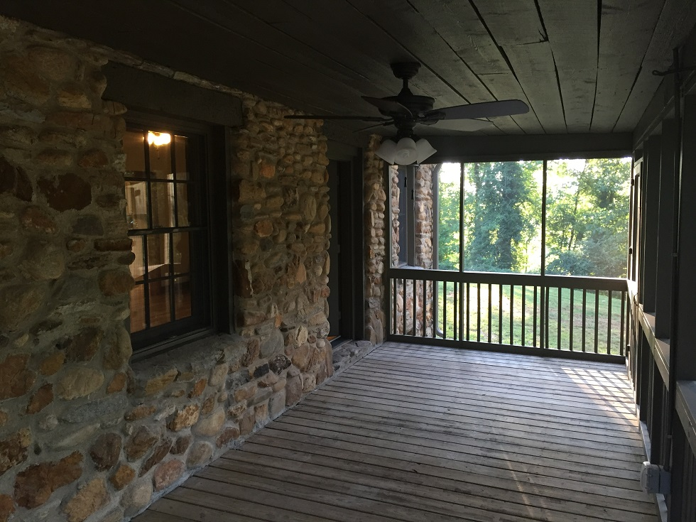 The screen porch was rehabbed to show off the original rough cut pine ceilings