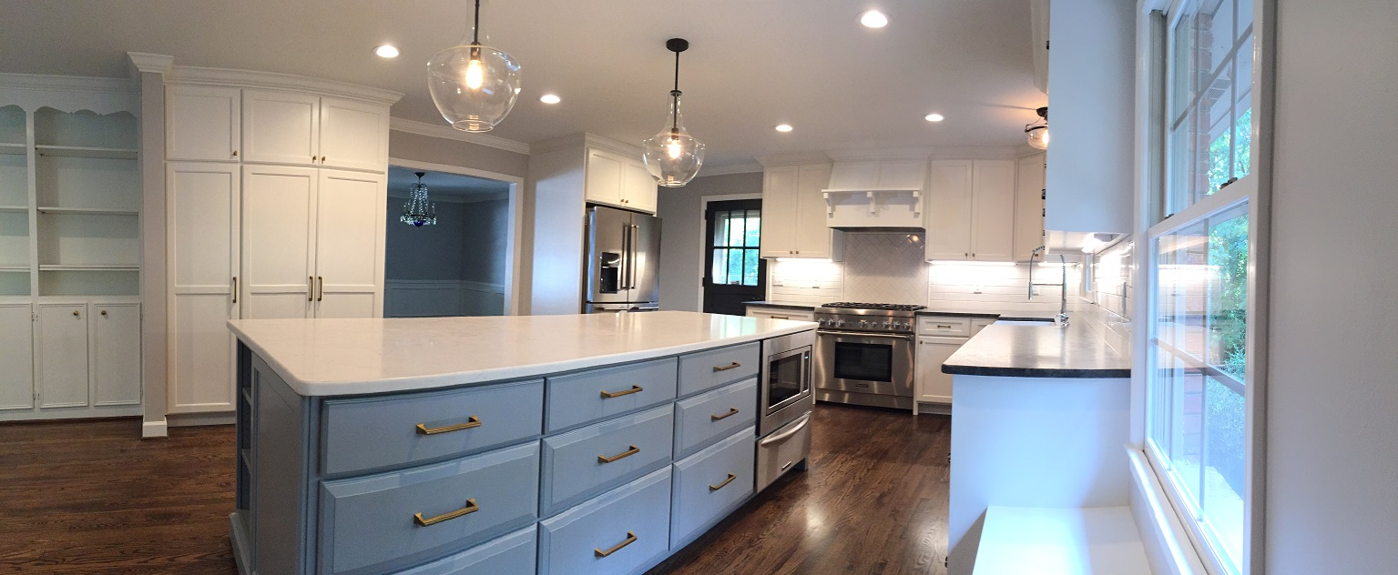 The kitchen was expanded and received new custom cabinets, quartz and brushed granite countertops, backsplash, and appliances. The lighting and floors were also updated