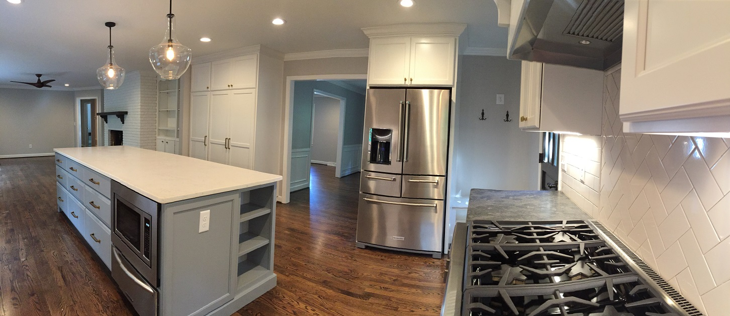 The wall between the kitchen and living room was removed to expand the kitchen and open the space between the two rooms. The cased opening into the dining room was also expanded