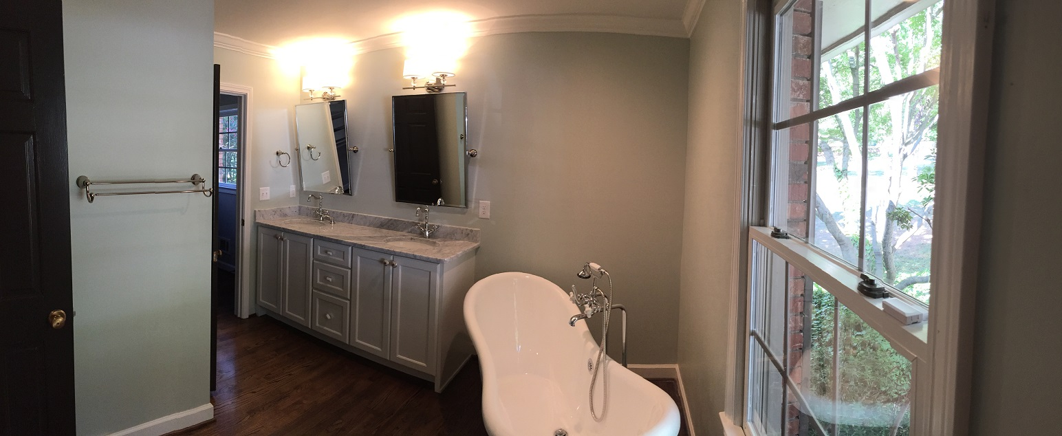 The master bath also has a freestanding tub and a custom vanity with a marble countertop
