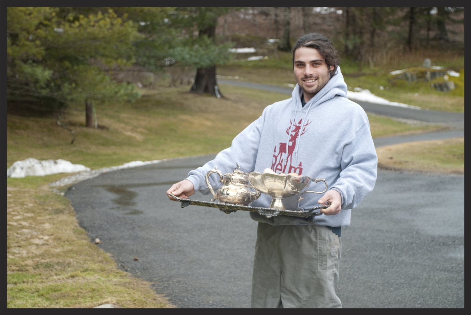 Eli holding a batch of fresh eggs from the coop!