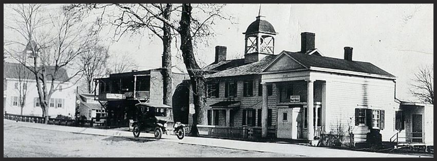 (L-R) 1787 Court House, Fowler's Garage, Library, Post Office, Bedford, NY, c. 1910