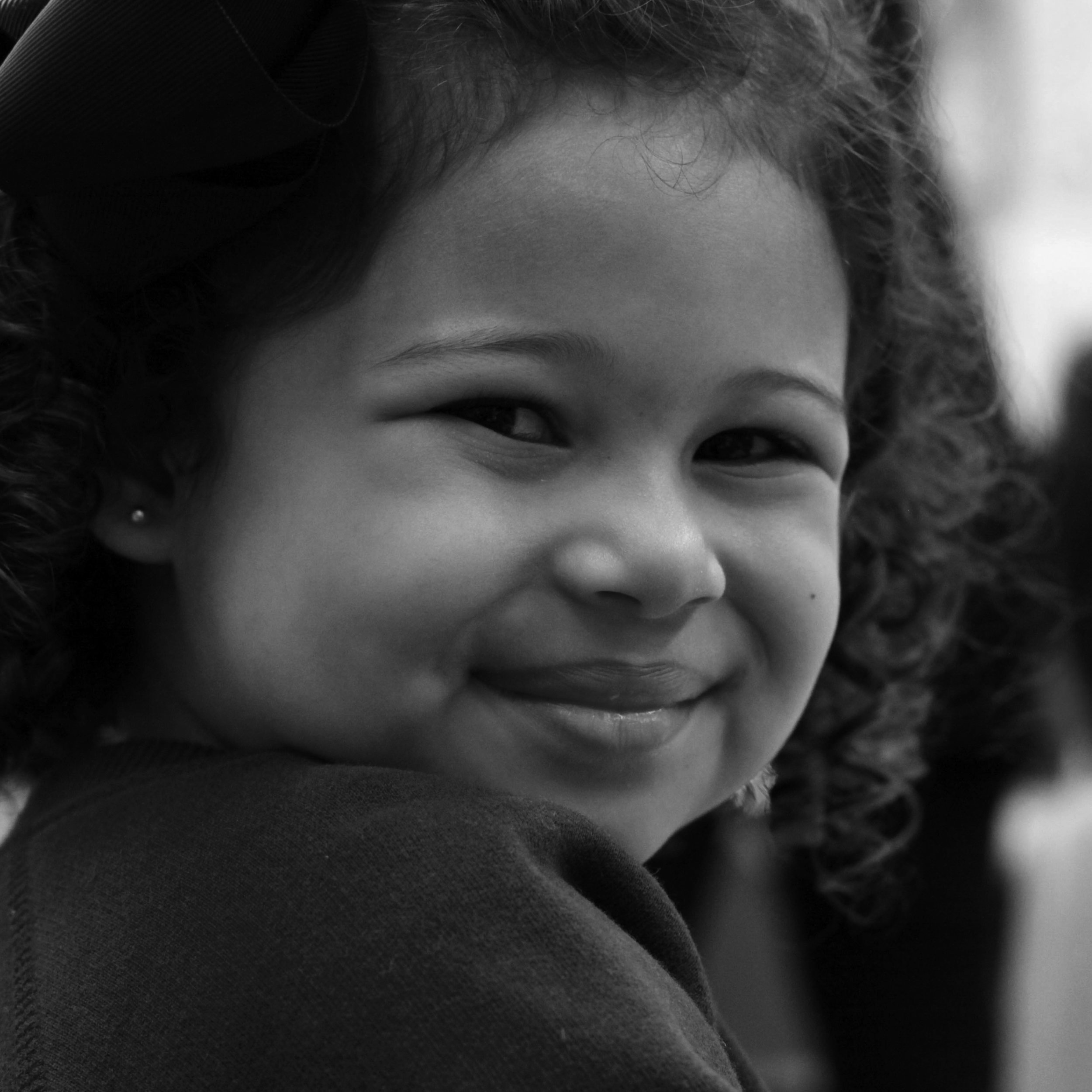 A child smiles for the camera.