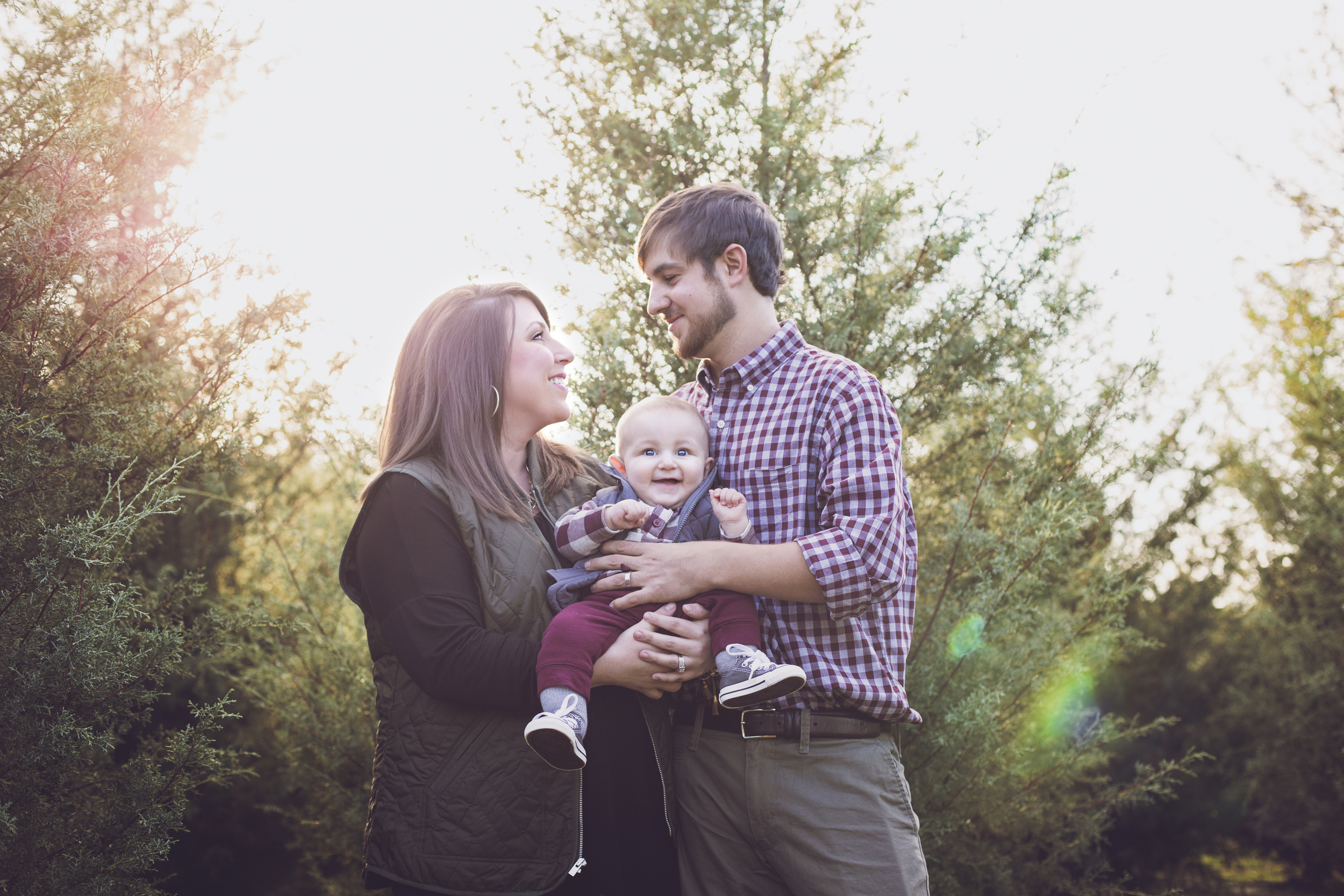 """""""Love love love working with Lindsey and her husband! She had awesome props, produced beautiful pictures and got the photos to me super fast! Can't wait to make our Christmas cards with our beautiful pictures! I've already planned our sons 1st birthday session!"""" - Taylor Parker"""