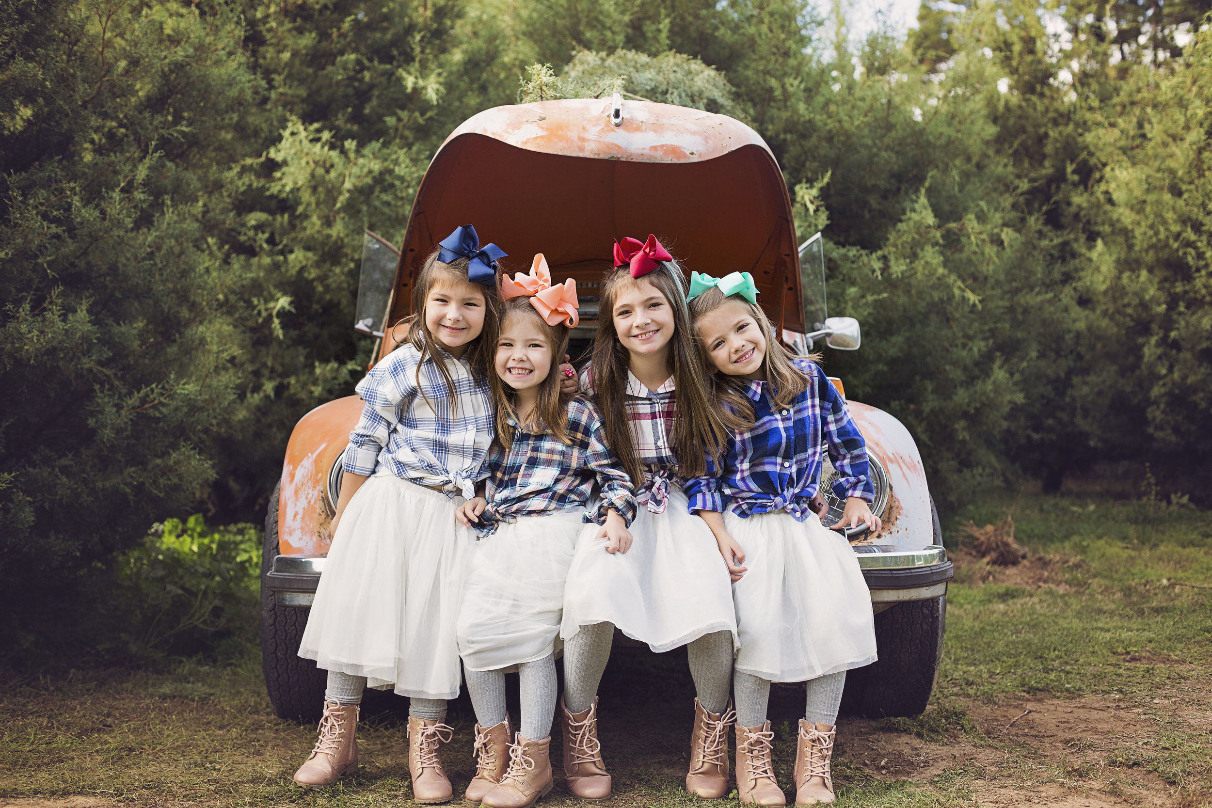 """""""I am so grateful for Lindsey's patience and talent in photographing my two daughters and two nieces each and every time. We are always a circus and she just goes with the flow! Her pictures are always top-notch and capture the personalities of each child perfectly. Thank you for all of our memories over the years!!""""  - Lauren Roberts"""