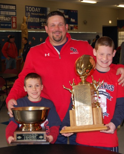 St. Rita High School Head Football Coach Todd Kuska '90 with his sons Joey (left) and Jake.