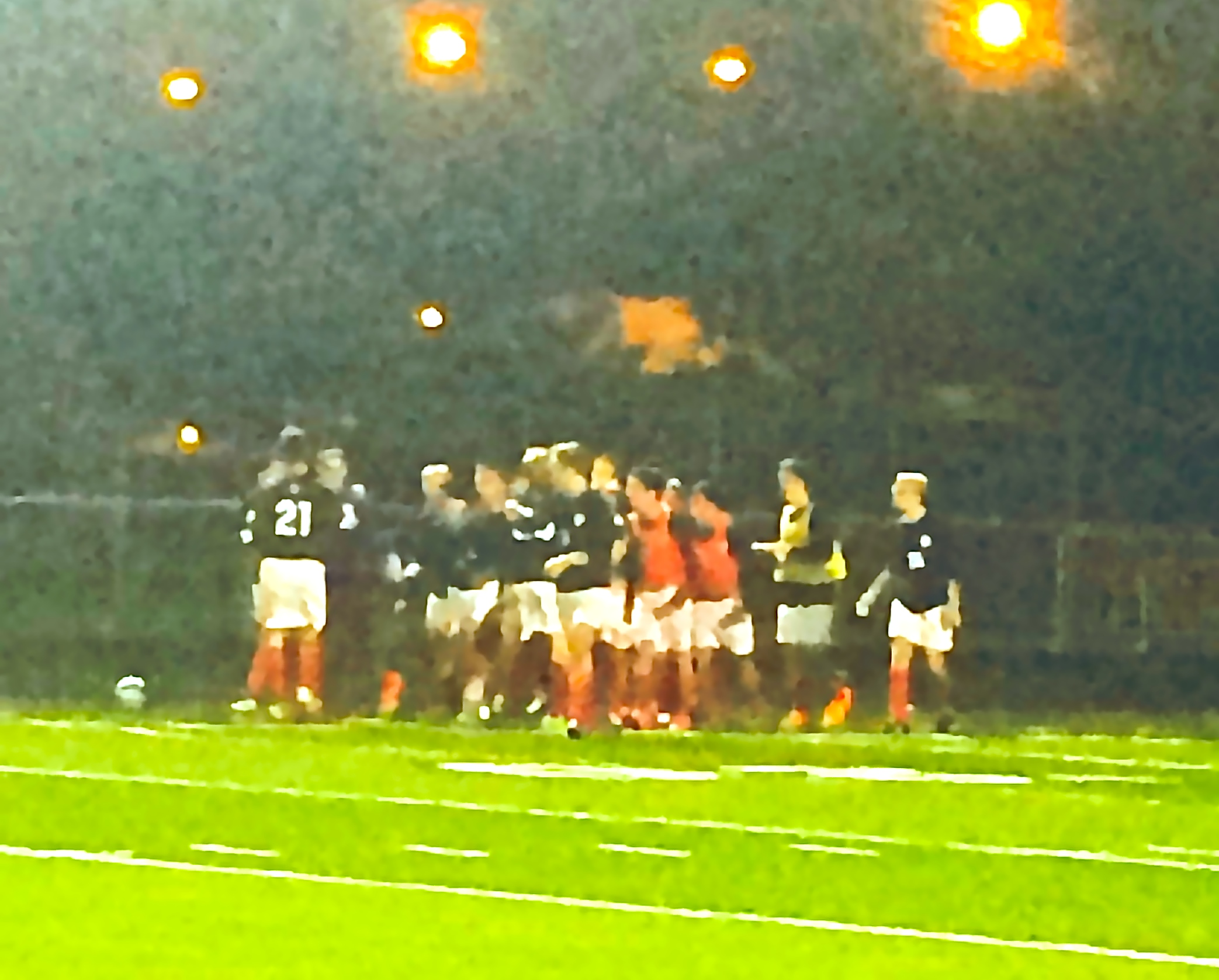 St. Rita Soccer players swarm goalkeeper Mike Long after game-winning save at Doyle Stadium!