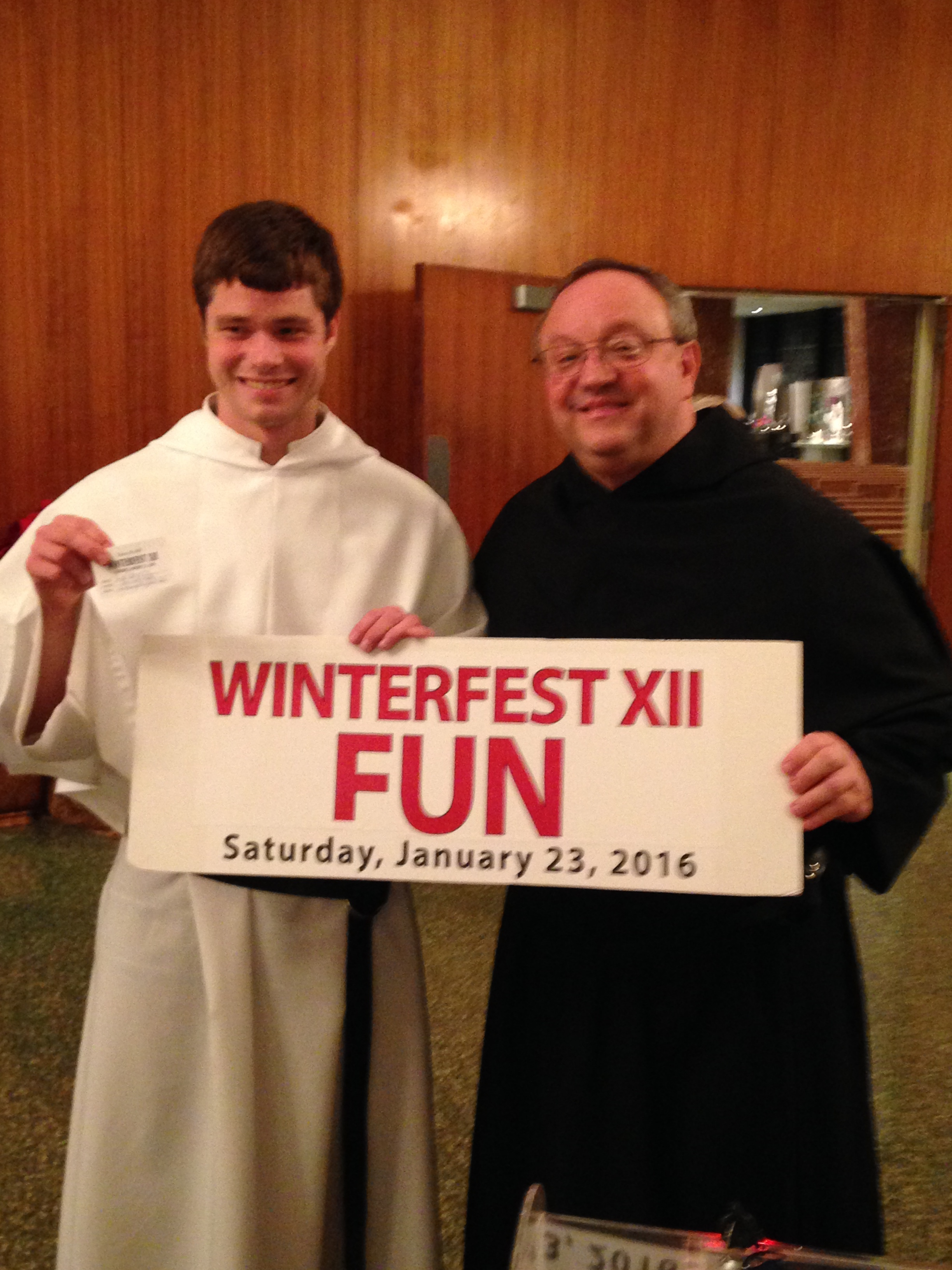 One of our Augustinian Men in Formation and St. Rita High School Chairman Fr. Bernie Scianna, O.S.A. '83 with the early-bird winning ticket!