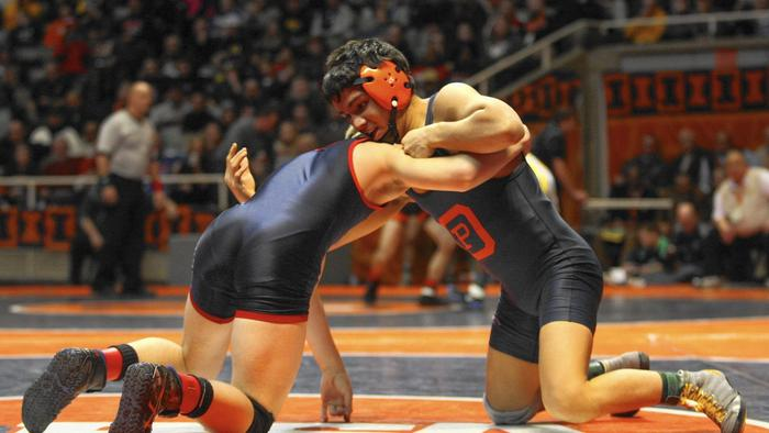 Silzer (left) competes in a tournament at University of Illinois last February (Photo:  Mike Mantucca / Daily Southtown)