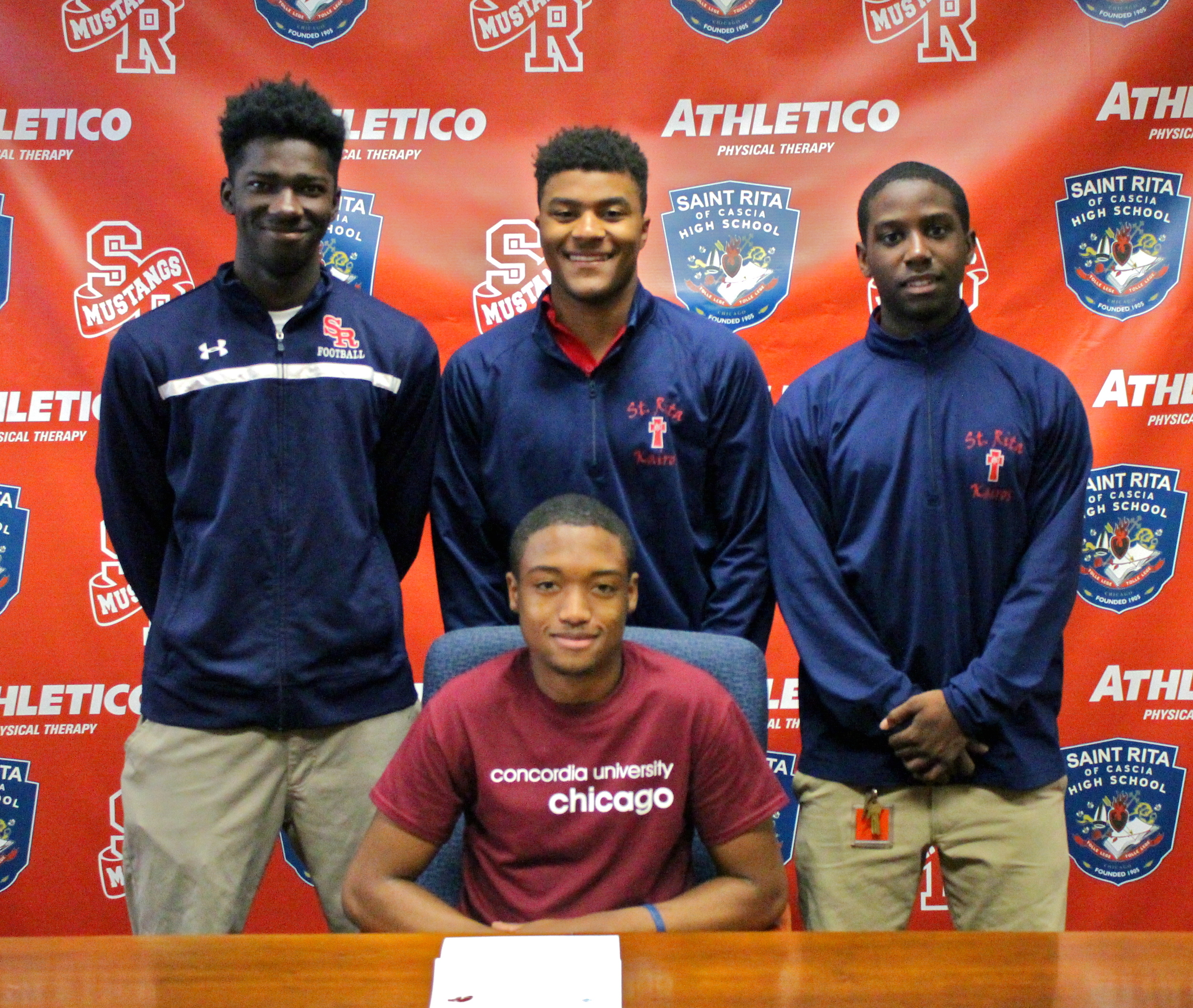 Tyrique Thomas with fellow Ritamen on signing day