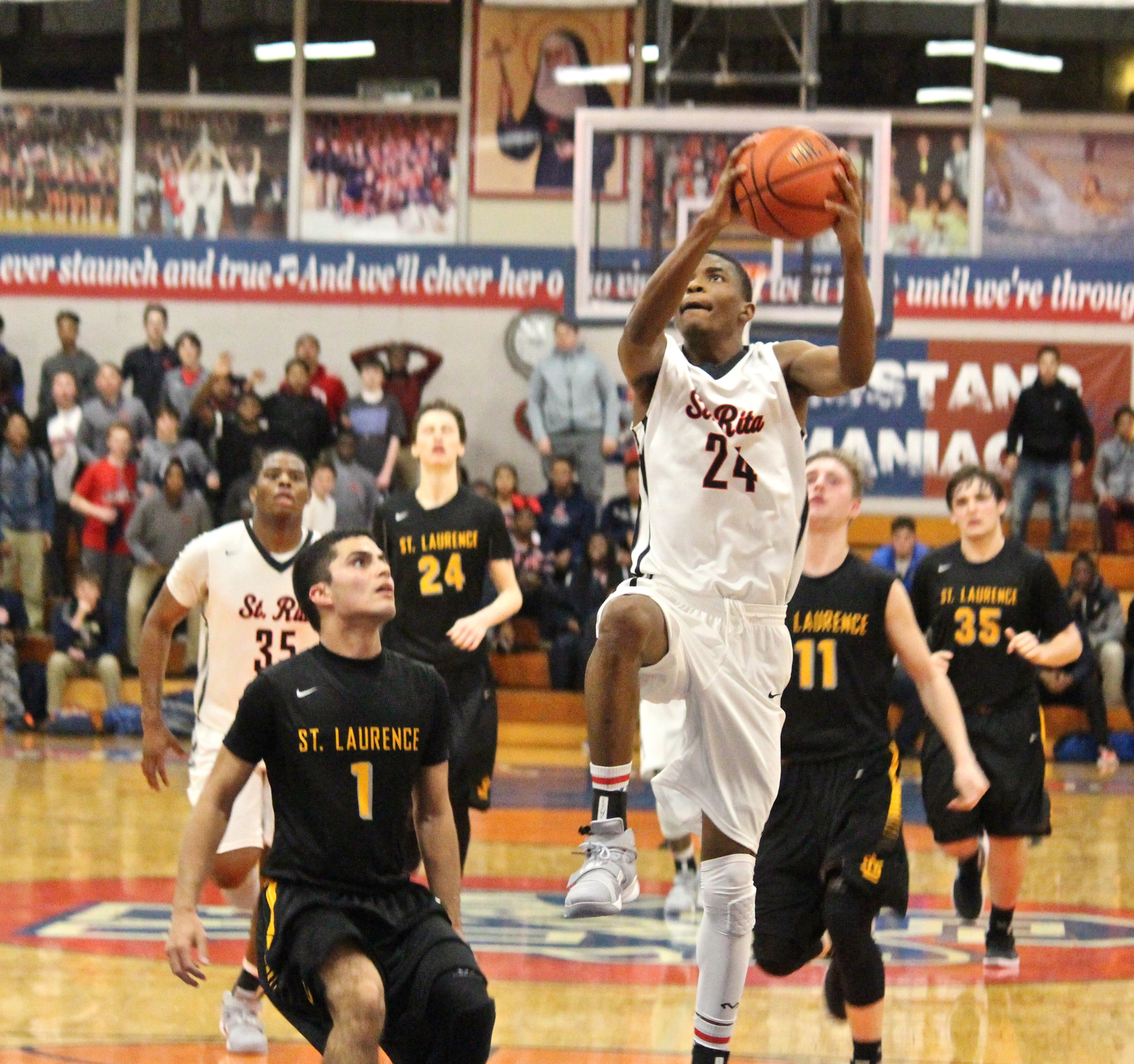 Christ Williams converts a break-away lay-up against St. Laurence.