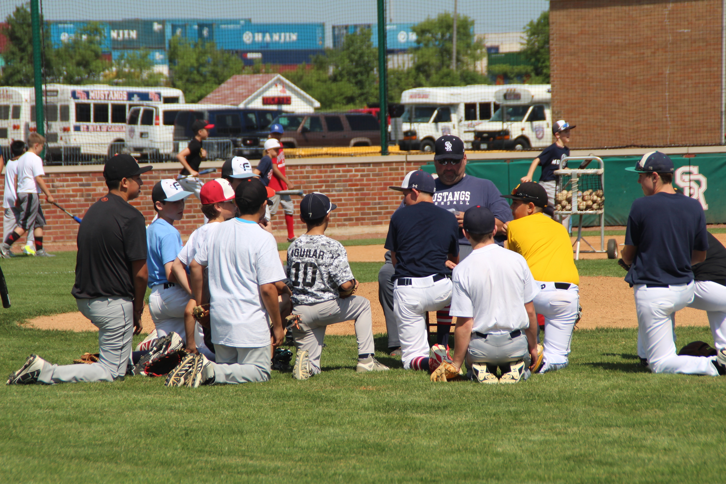 Coach John Nee' 93 talks to the baseball campers