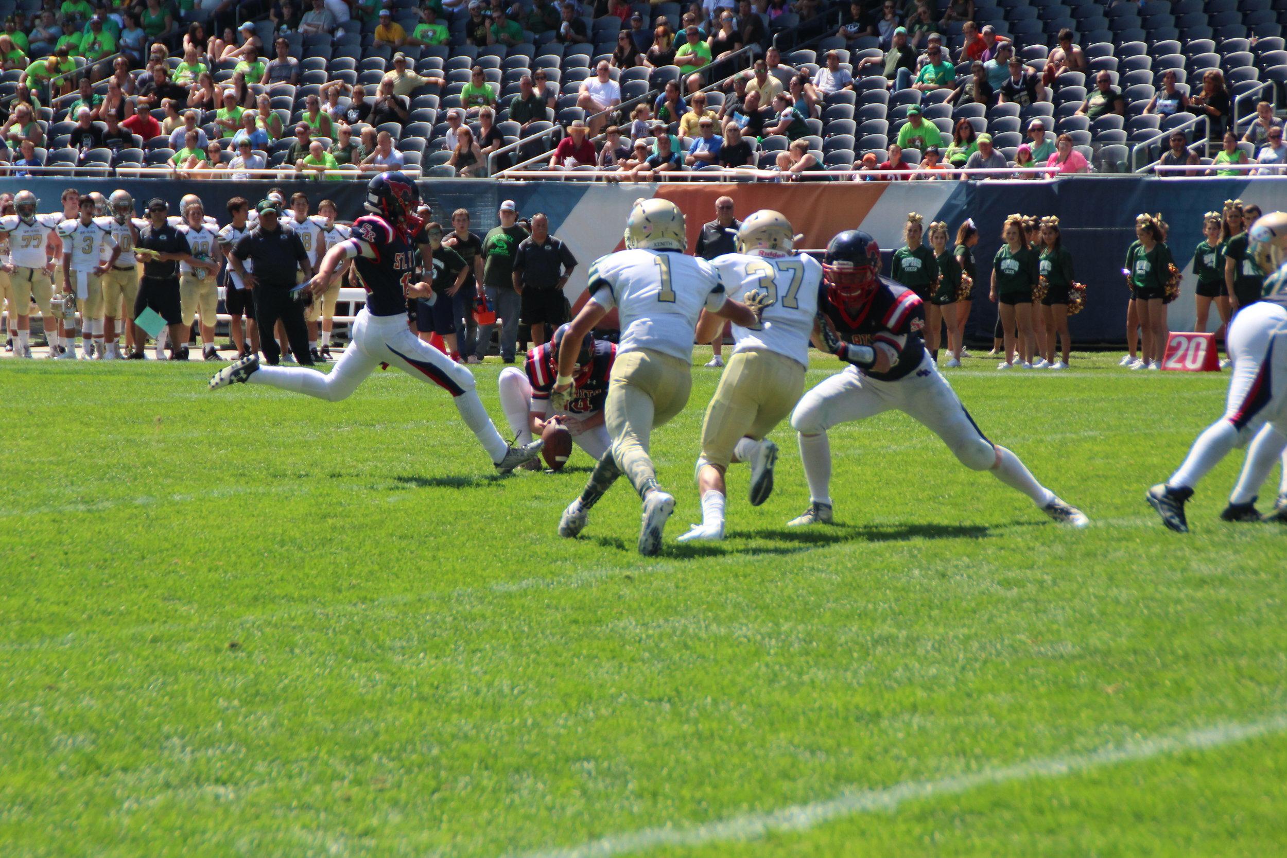 St. Rita Sophomore Kicker Gavin Mottl kicks an extra point at Soldier Field