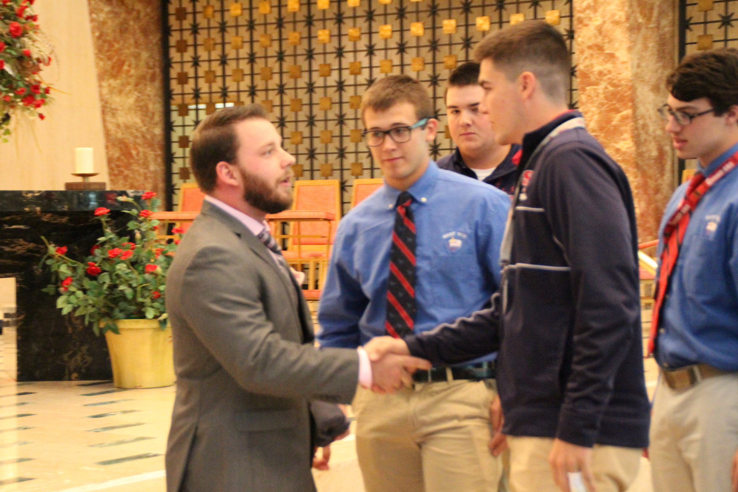 Marine Corps Veteran Dan McLaughlin '09 is thanked for his service by Senior St. Rita Student Government representative Connor Kelly '16.