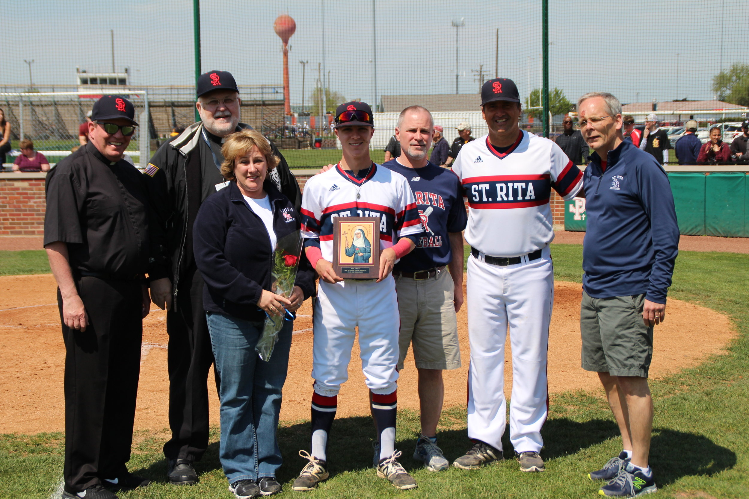 St. Rita senior Matt Verdun (center)