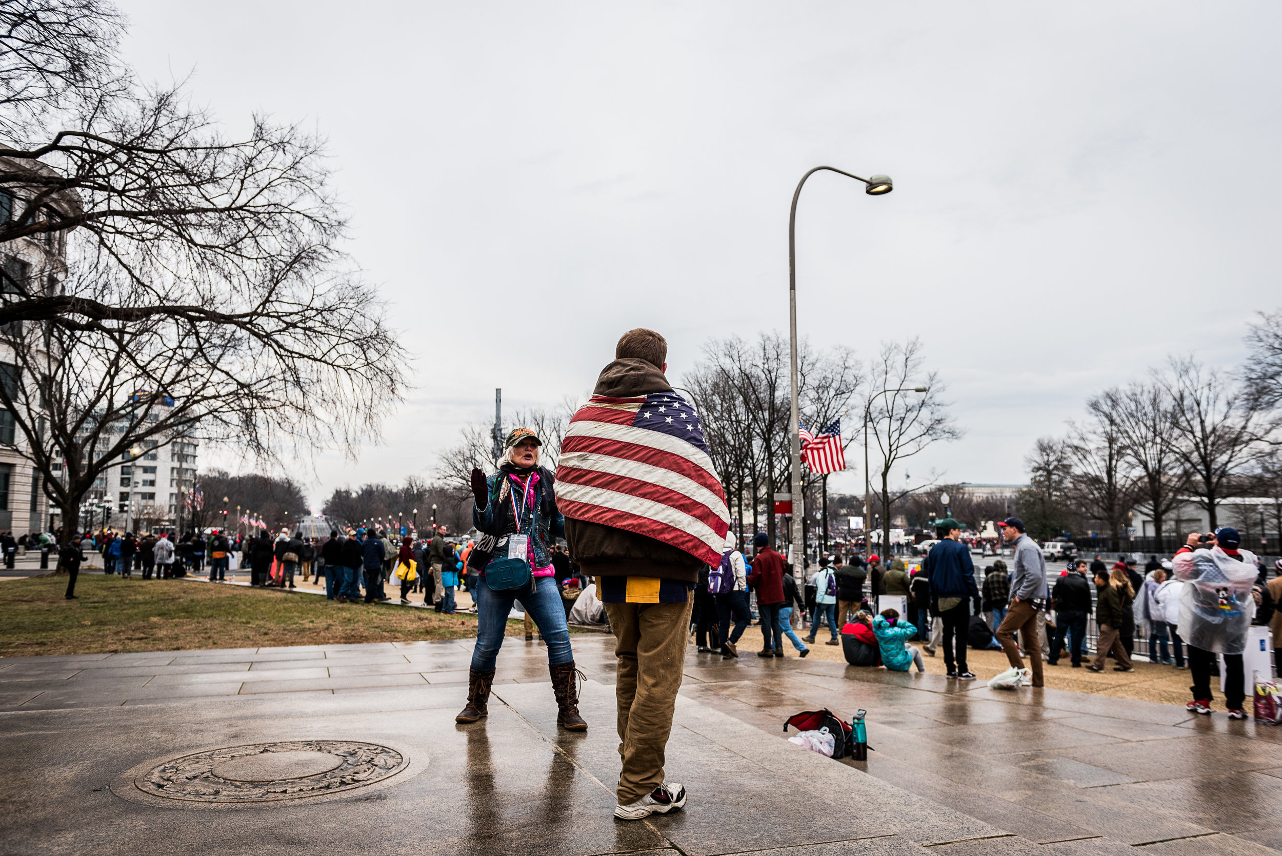 An inauguration attendee wears an American flag, Friday, January 20, 2017.