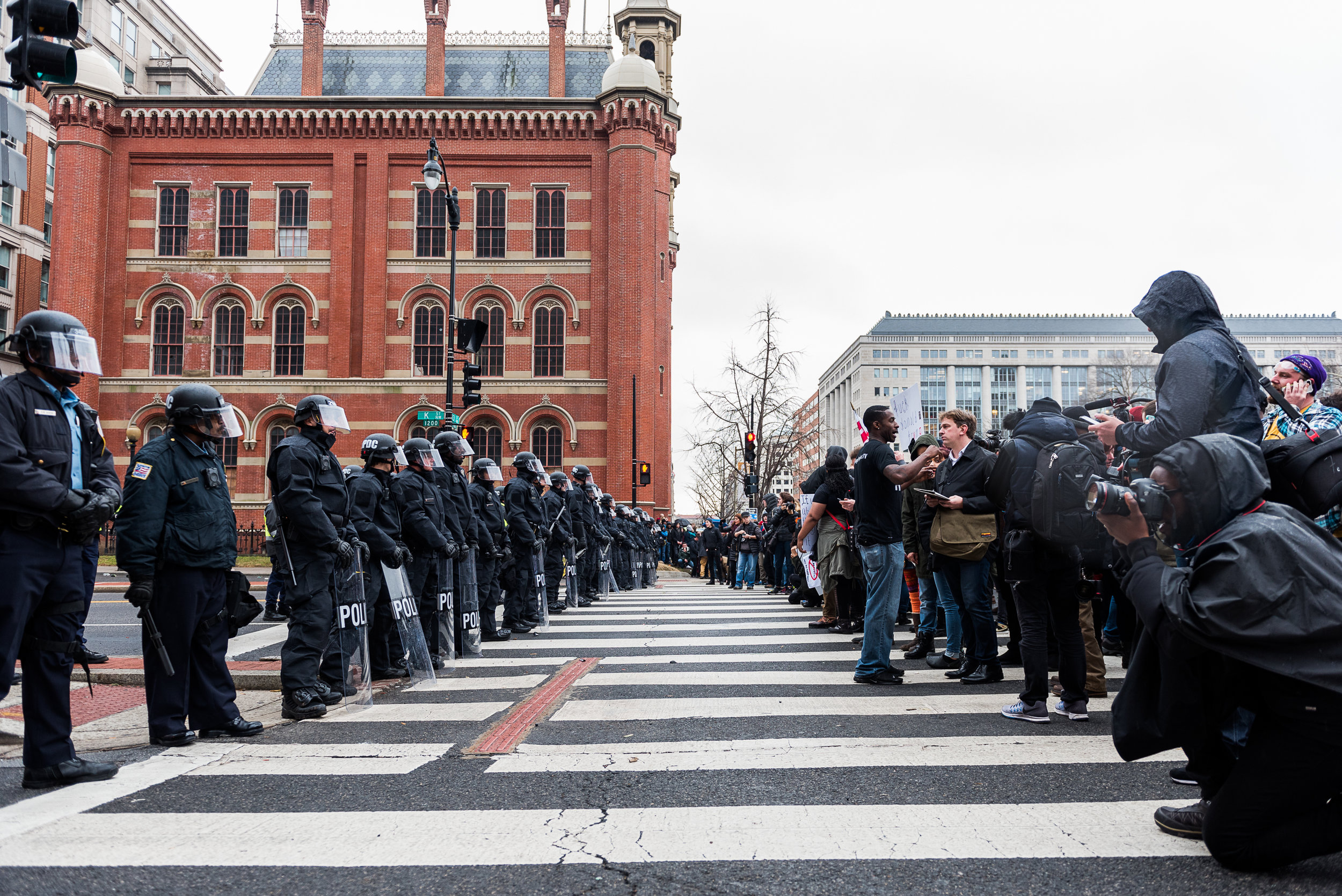 Police officers dressed in riot gear block K Street during a standoff with protesters, Friday, January 20, 2017.