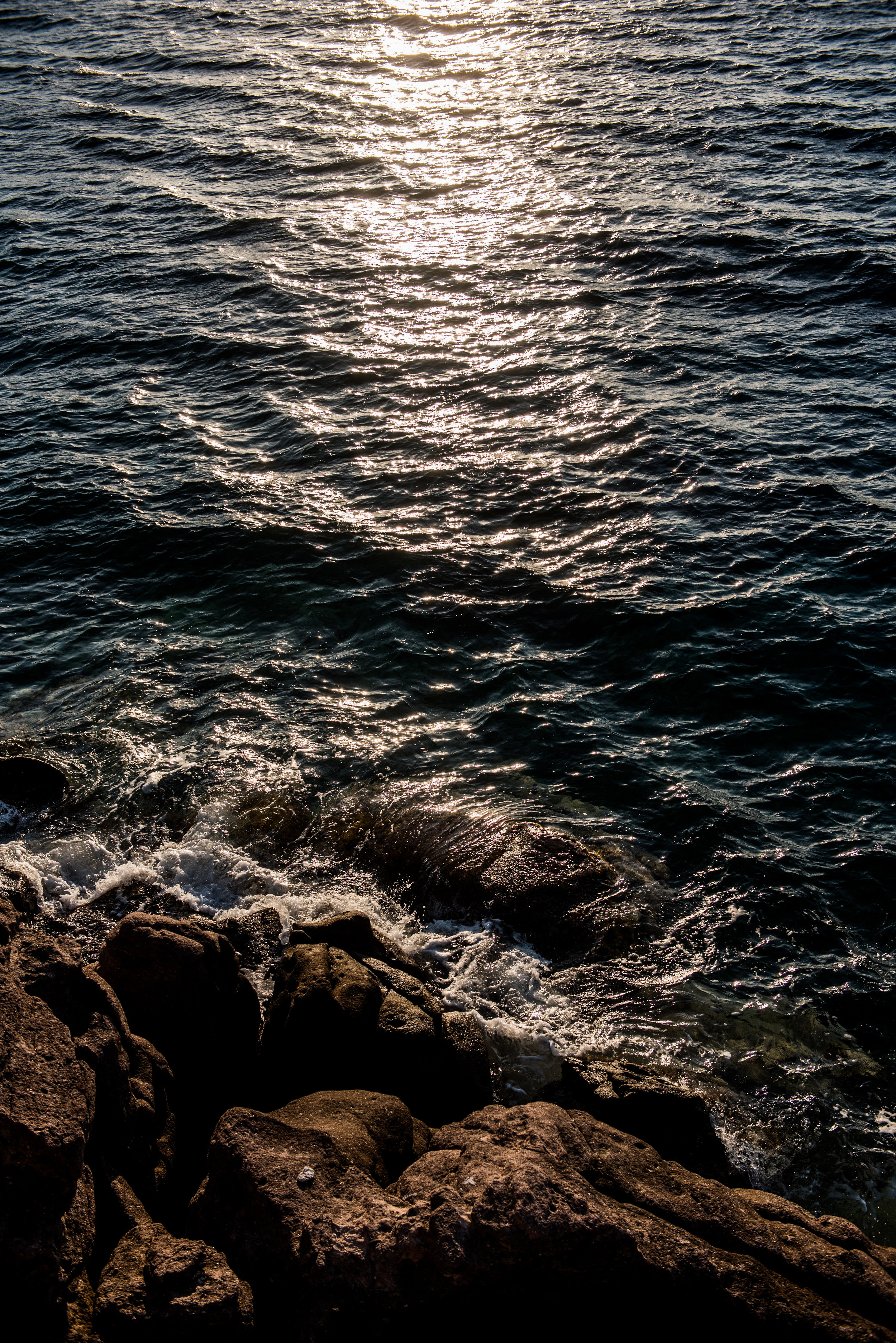 The sun sets on the Aegean Sea outside of Skala port