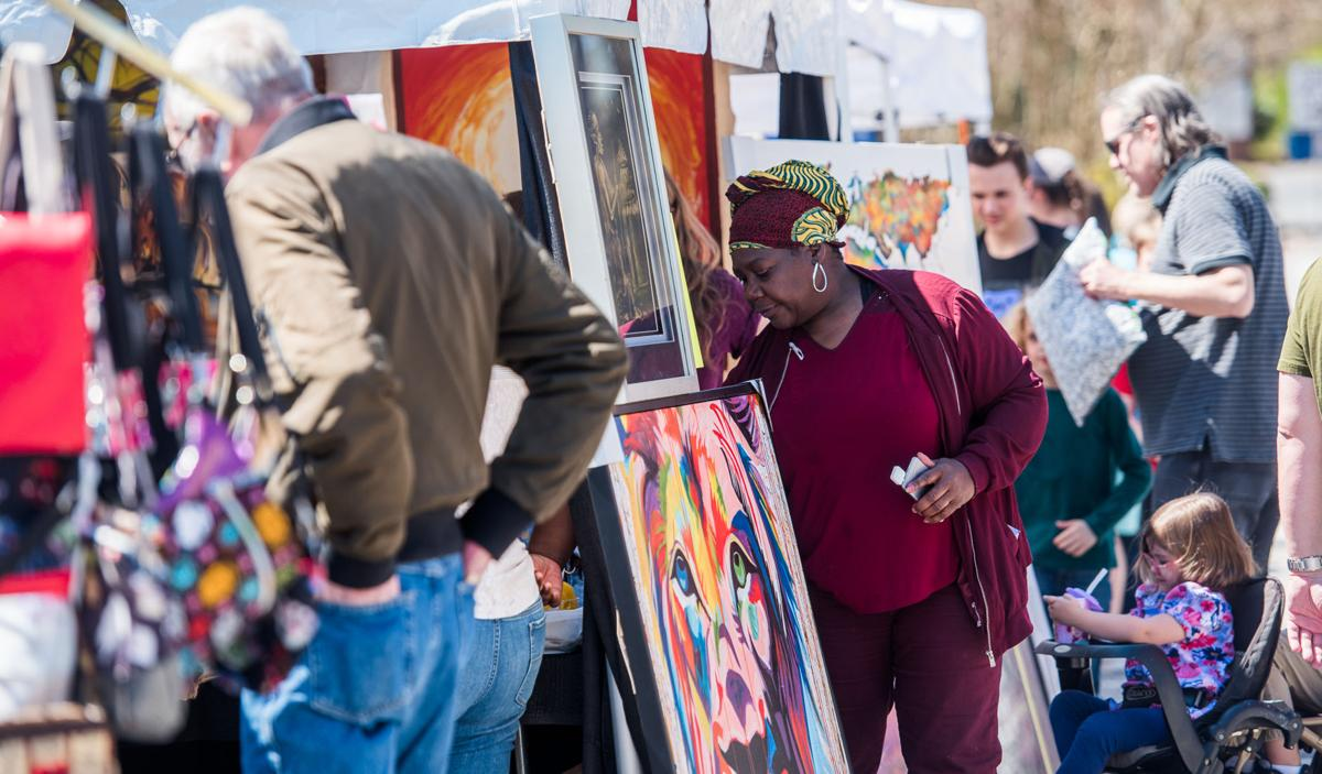 Attendees browse the vendor booths at the inaugural Mableton Spring Arts Festival at the Mable House on Saturday, March 23, 2019. (Photo: Cory Hancock)
