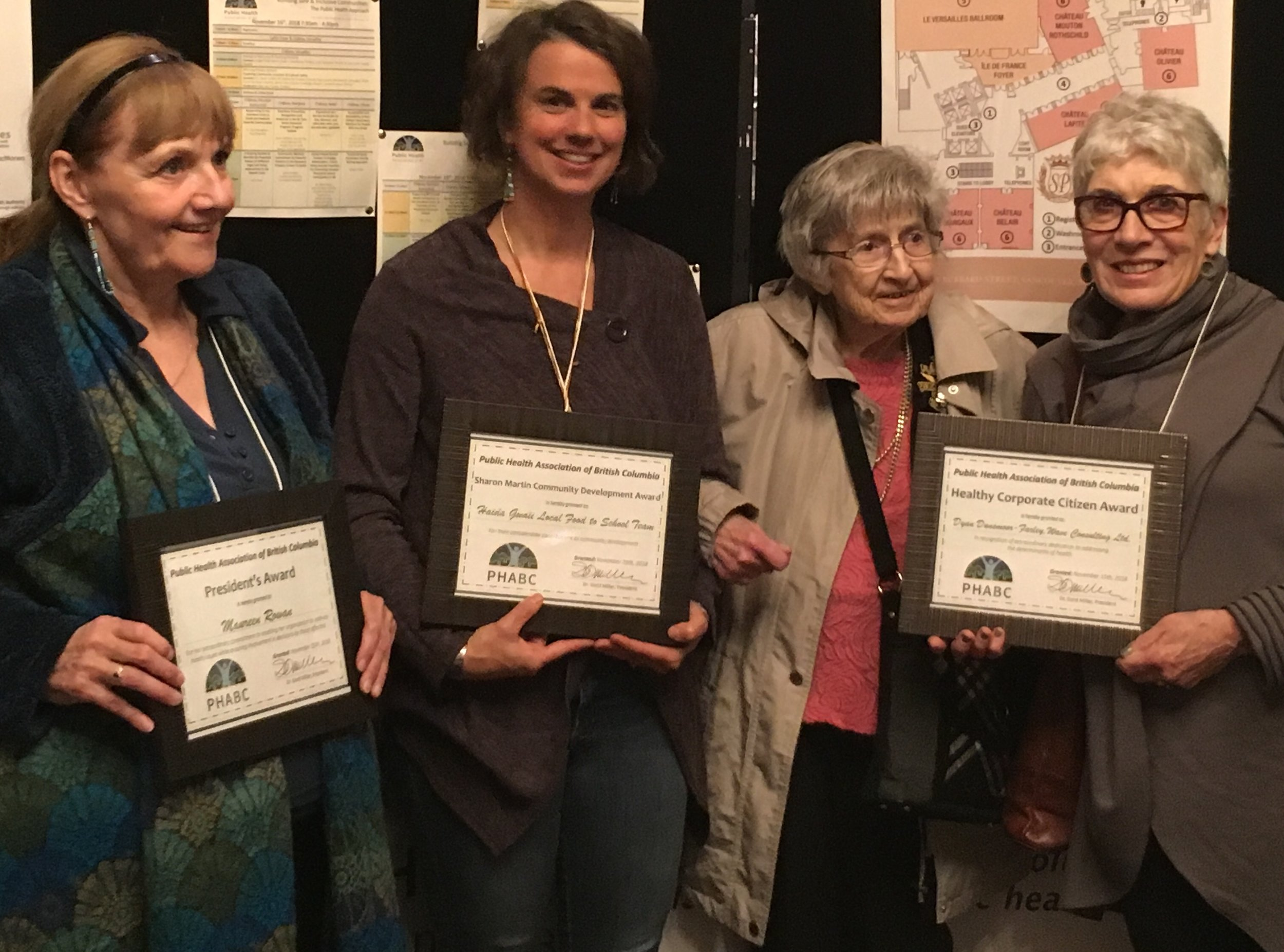 2018 PHABC Award winners (from left to right): Maureen Rowan from PHABC received the President's Award; Shelley Crack, community nutritionist and community capacity builder from Haida Gwaii received the Sharon Martin Community Development Award; 103-yr old Bertha Loewen received the Phyllis M. Baird Memorial Award for her lengthy service as a public health nurse in BC; Dyan Dunsmoor-Farley, Managing Director of Wave Consulting, received the Healthy Corporate Citizen Award for her extraordinary dedication to addressing the determinants of health; and Dr. James Frankish (missing from photo) received the Award of Merit for his prolific research and promotion of healthy Canadians.