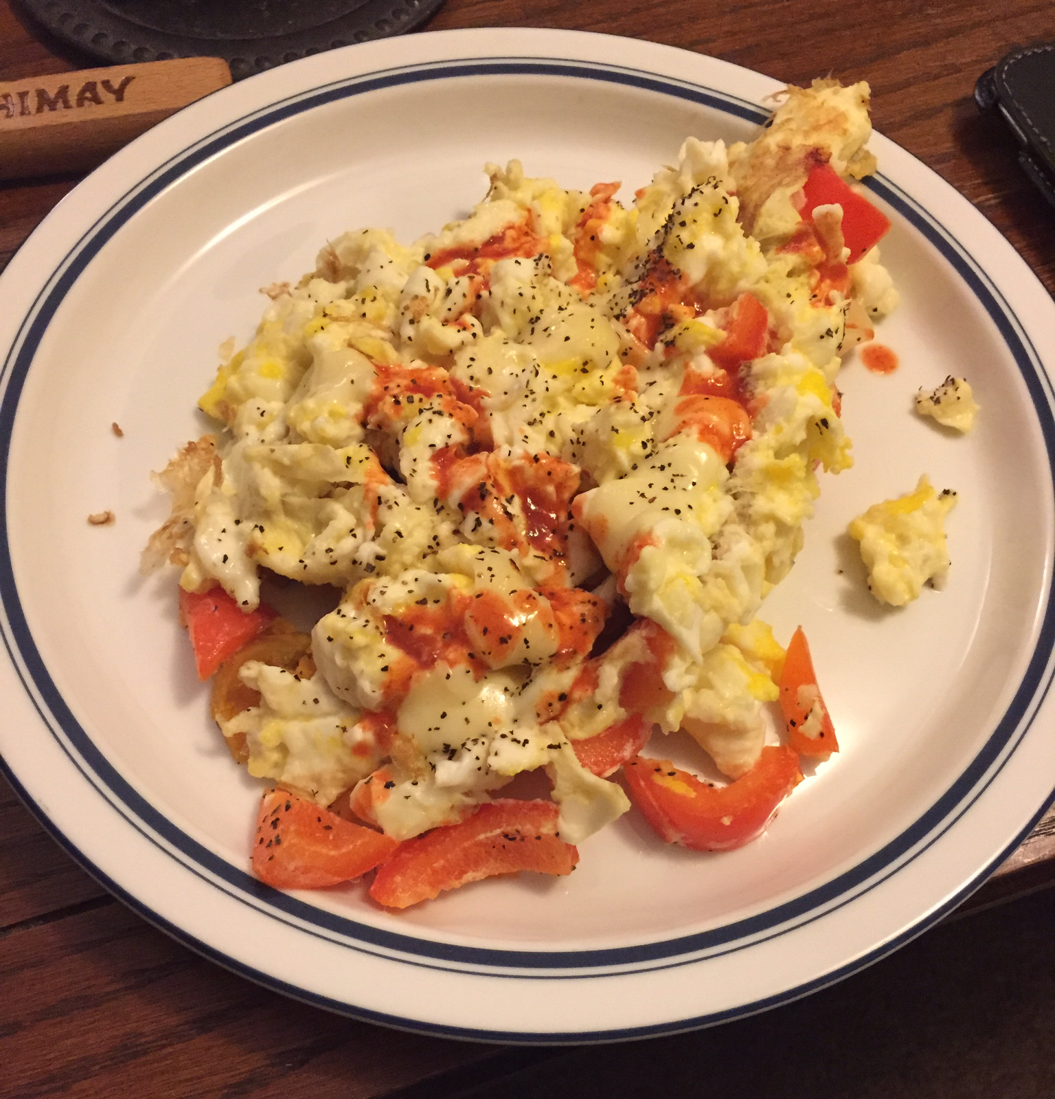 Here is the finished product - whole eggs, egg whites, sliced red pepper, black pepper, 1 slice of deli provolone and some hot sauce!