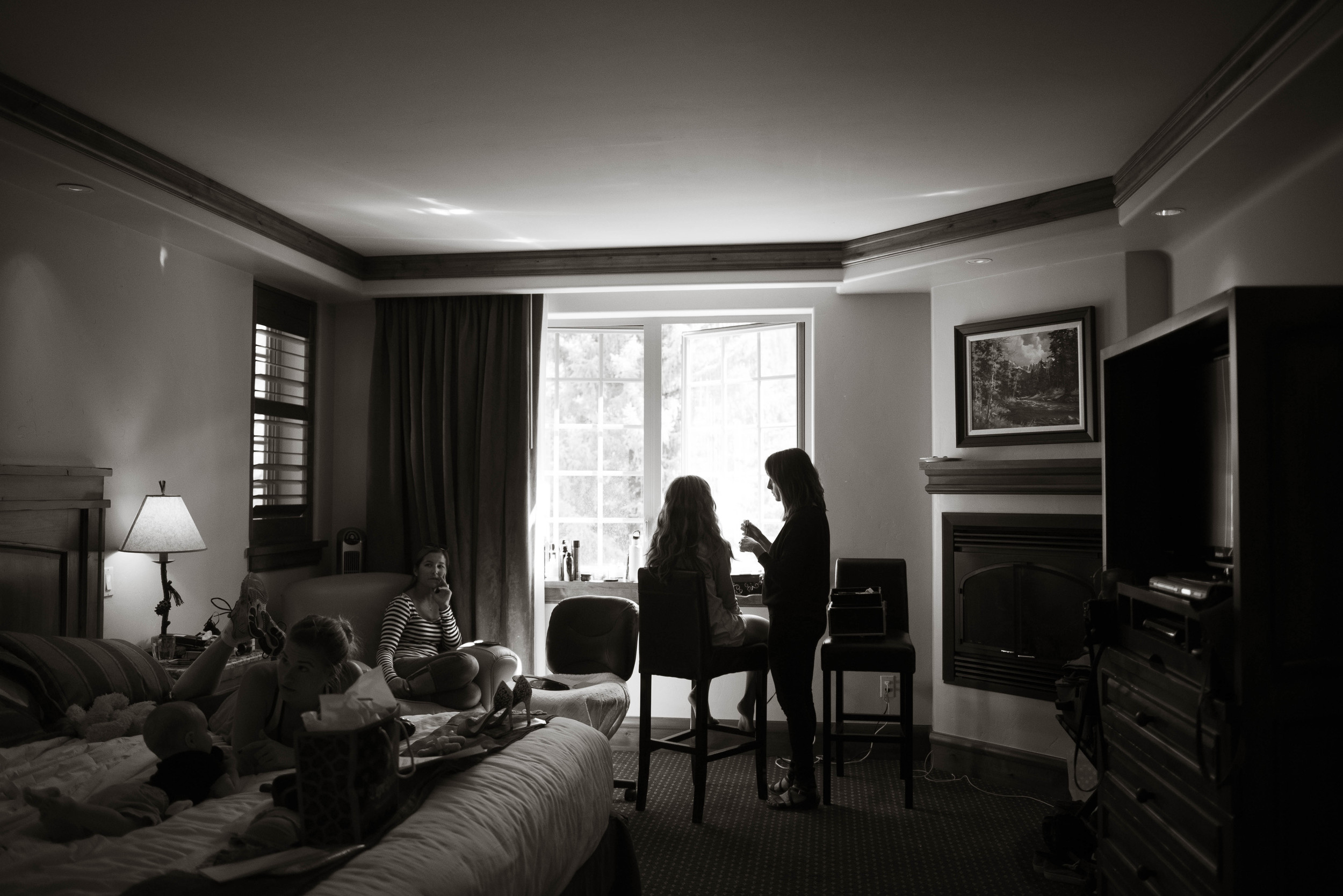 Loni from  Side Door Salon doing Teghan's hair and makeup in her room at the  Tivoli Lodge .