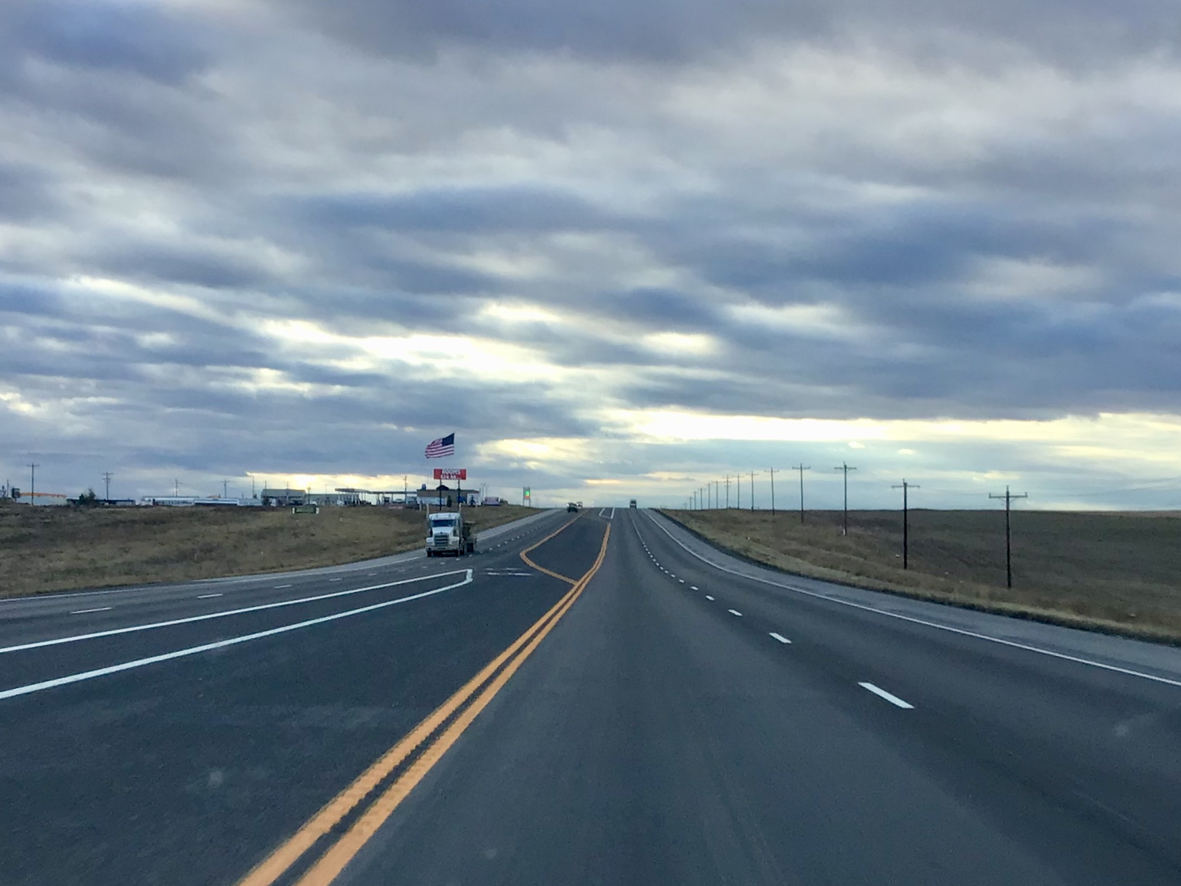 "During the height of the boom, Highway 85 between Williston and Watford City was called North Dakota's ""most dangerous road."" The NDDOT upgraded the road from a two-lane to a four-lane highway with a turning lane to address the increases in truck traffic."