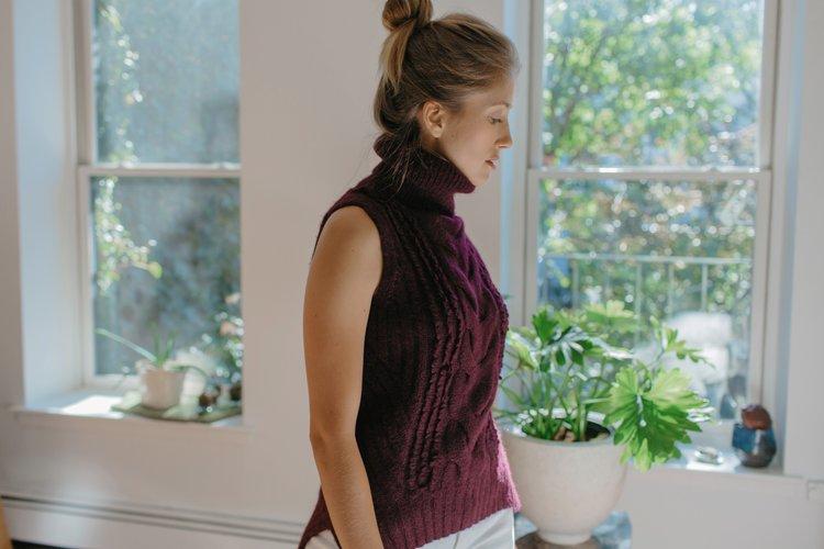 Jenna wears Sofia sweater in Bordeaux   Made in super, soft alpaca-blend yarn hand-knit by Peruvian artisan women,with LOVE
