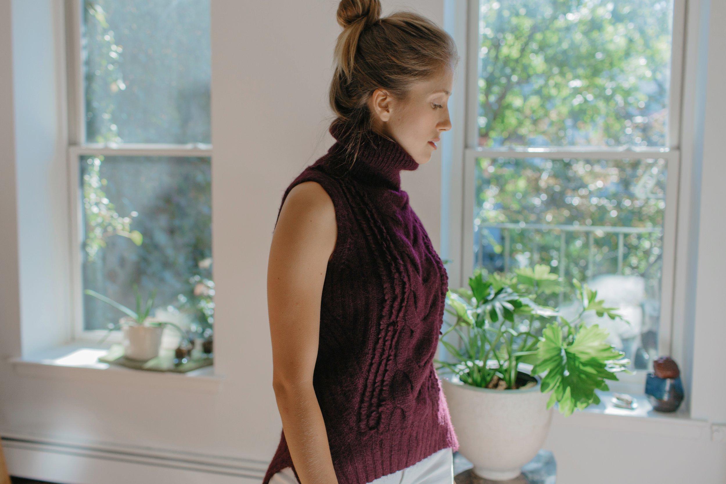 Jenna wears  Sofia sweater  in Bordeaux | Made in super, soft alpaca-blend yarn hand-knit by Peruvian artisan women,with LOVE